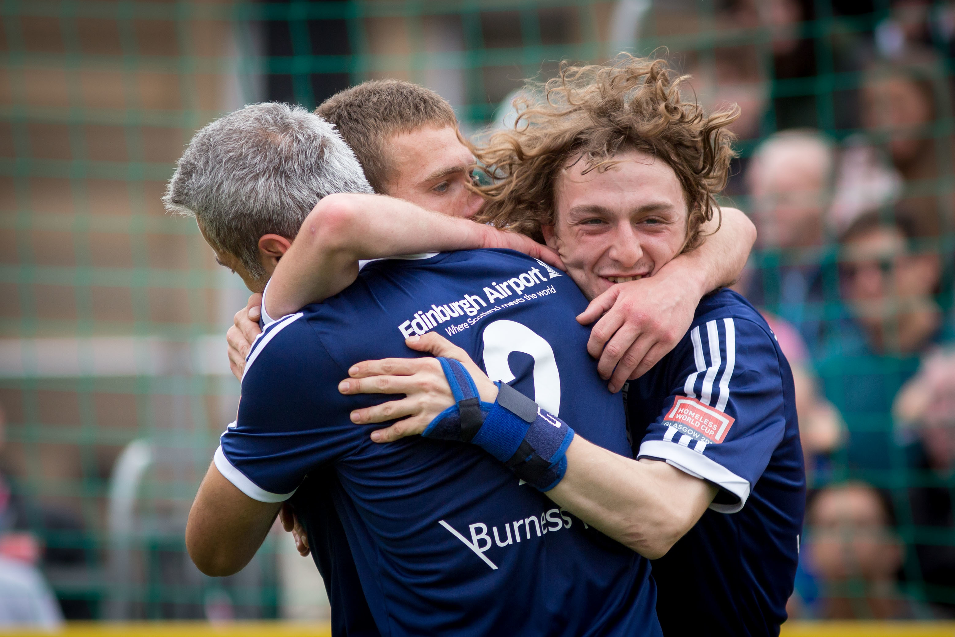 Scotland players celebrate a victory against Grenada