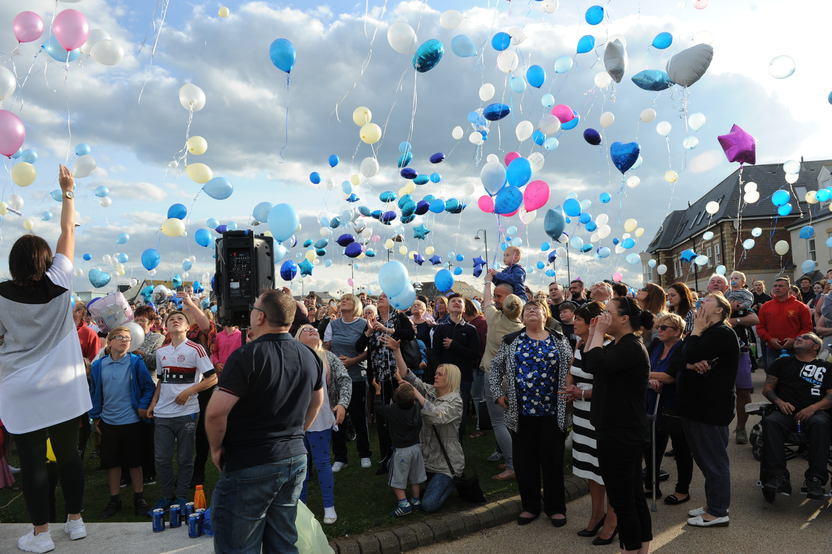 Hundreds of people release balloons at the vigil for Megan Bell.
