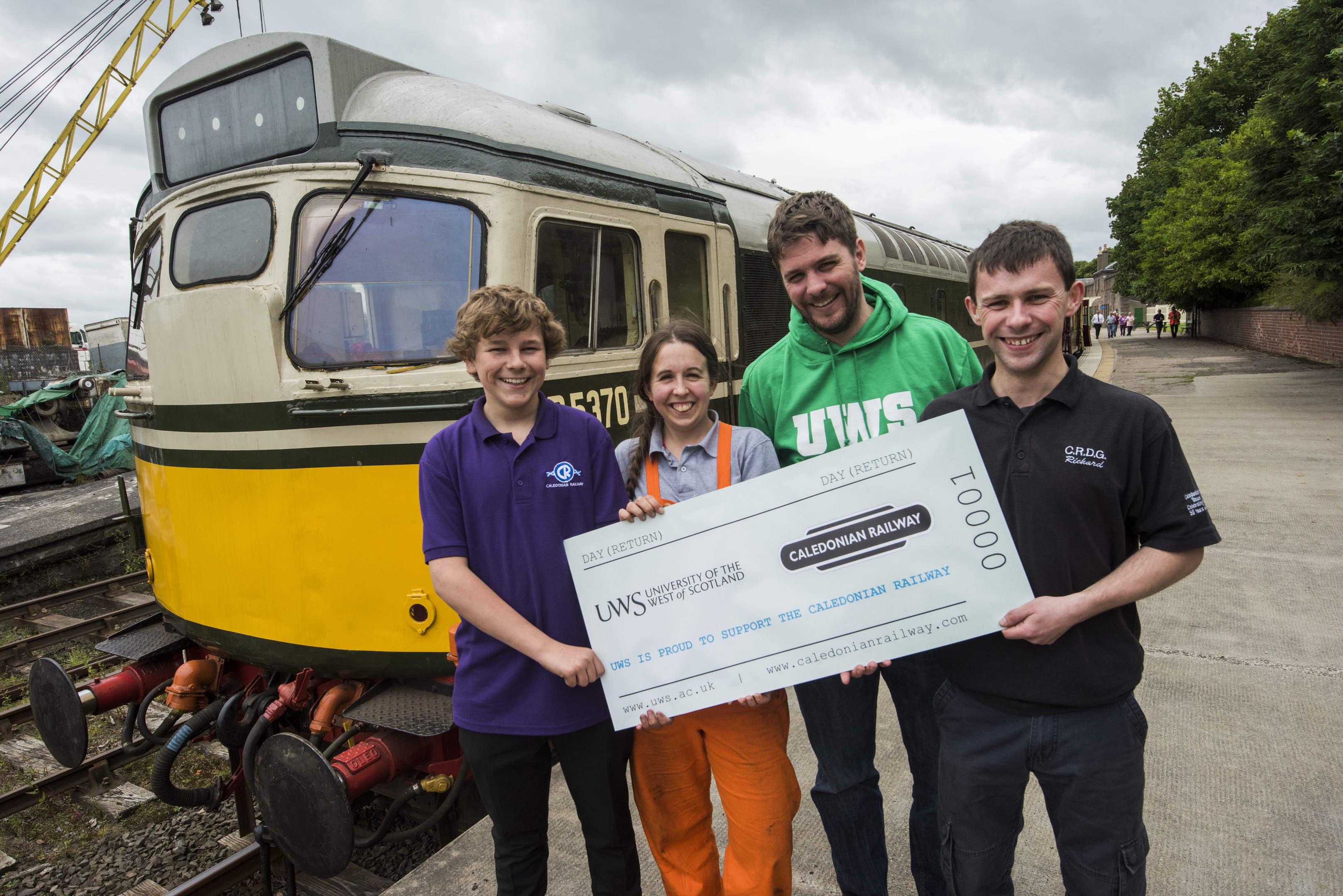 Pic shows (left to right): Caledonian Railway volunteer Ranald Simmons, with University of the West of Scotland researchers Kirsty Soutar and Sandro Carnicelli, and railway volunteer Ged Scott