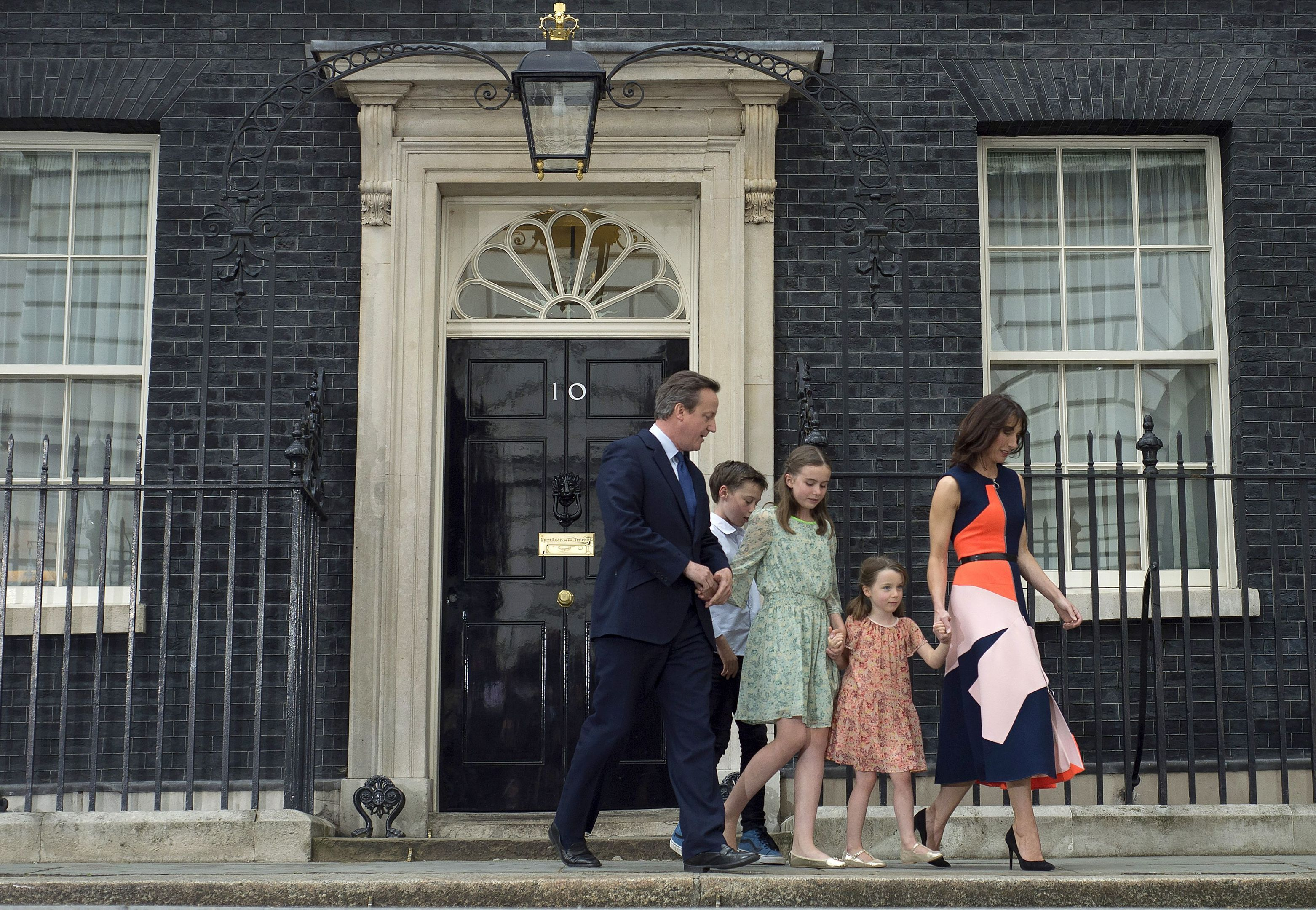 David Cameron with wife Samantha and children Nancy, 12, Elwen, 10, and Florence, 5, outside 10 Downing Street in London before leaving for Buckingham Palace for an audience with the Queen to formally resign.
