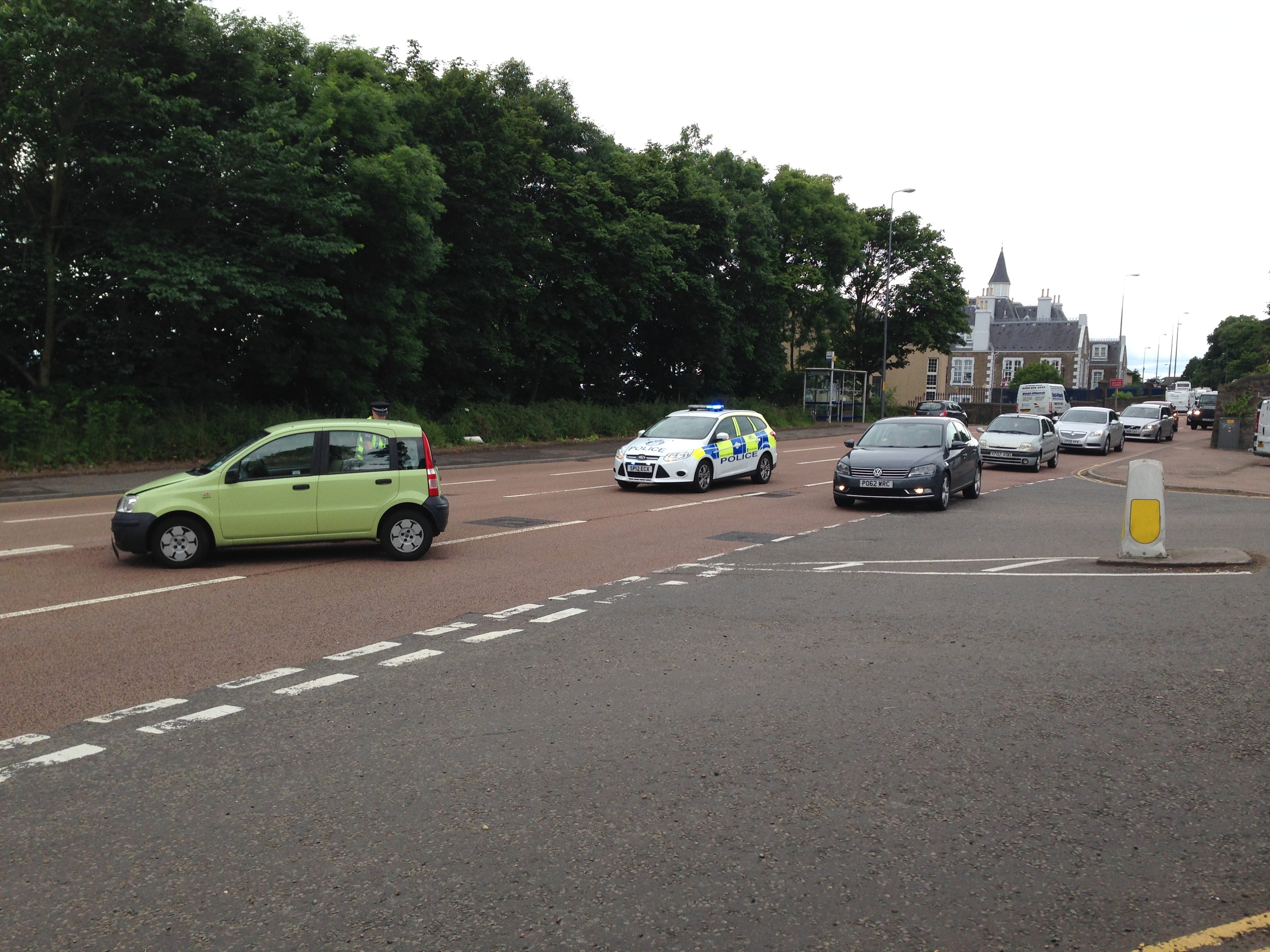 One lane on Broughty Ferry  Road is still blocked.