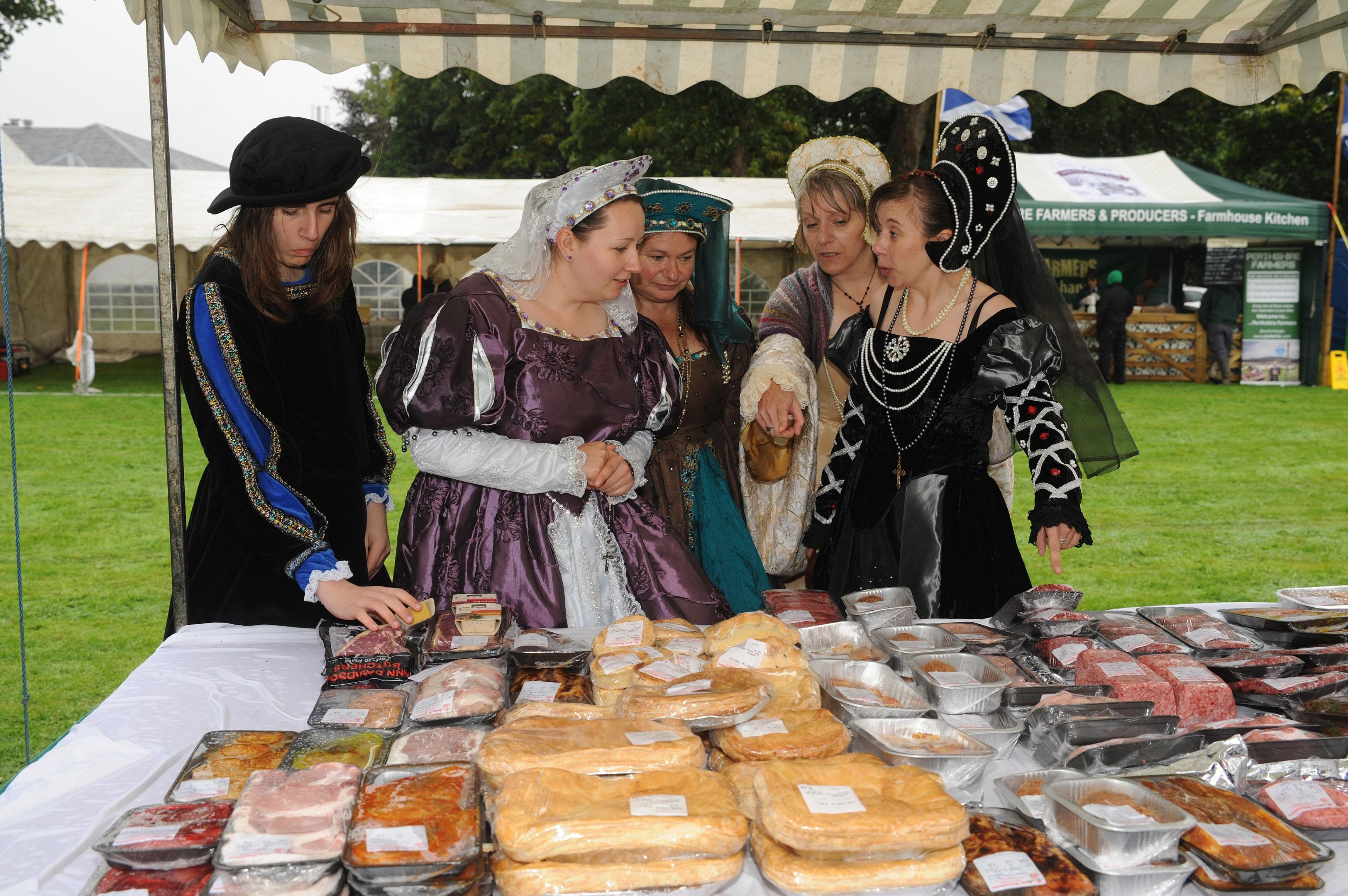 Mary with her servants look at one of the stalls at last year's festival.