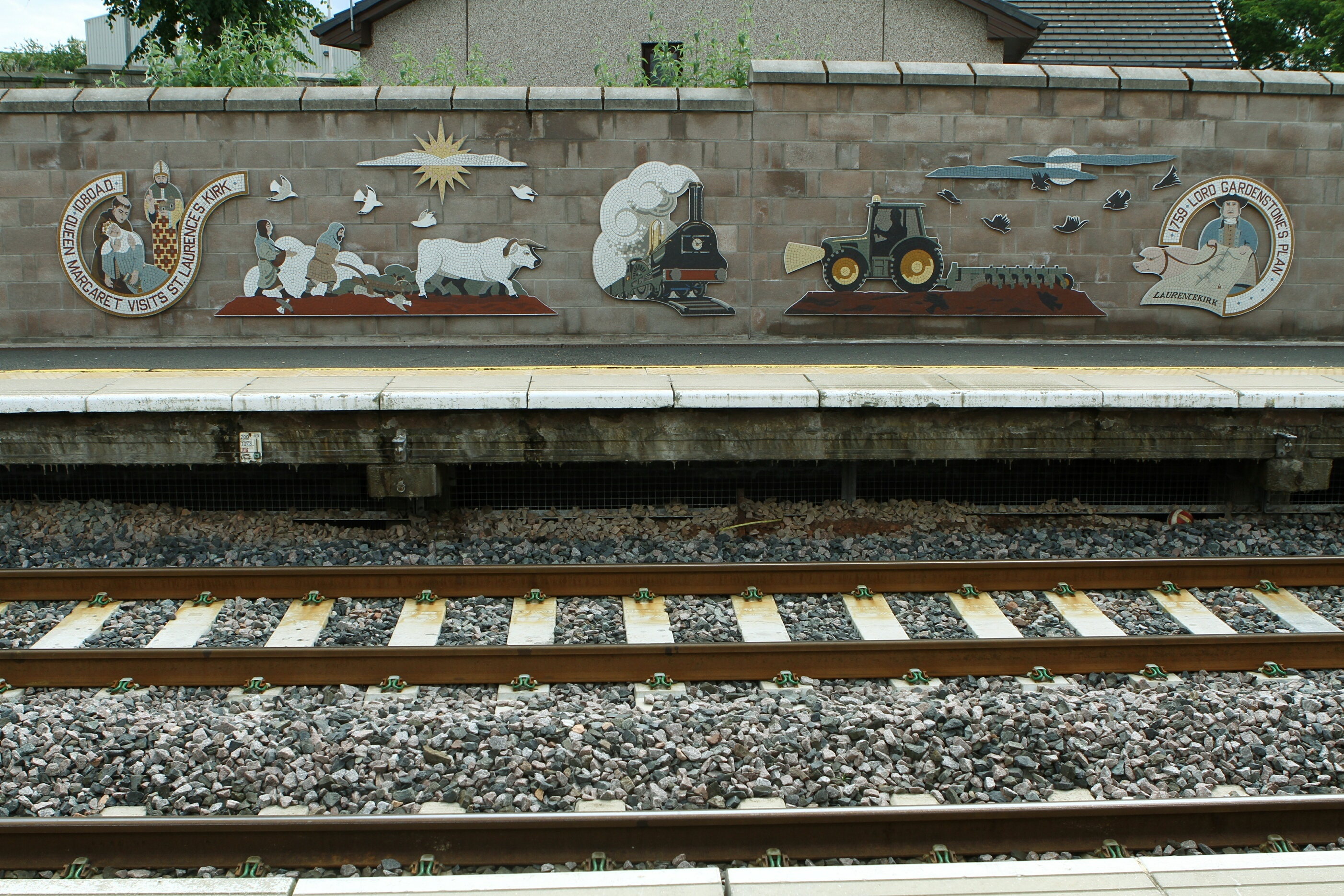 The mosaic by Alan Potter on the platform at Laurencekirk Railway Station, which depicts the heritage of the area.