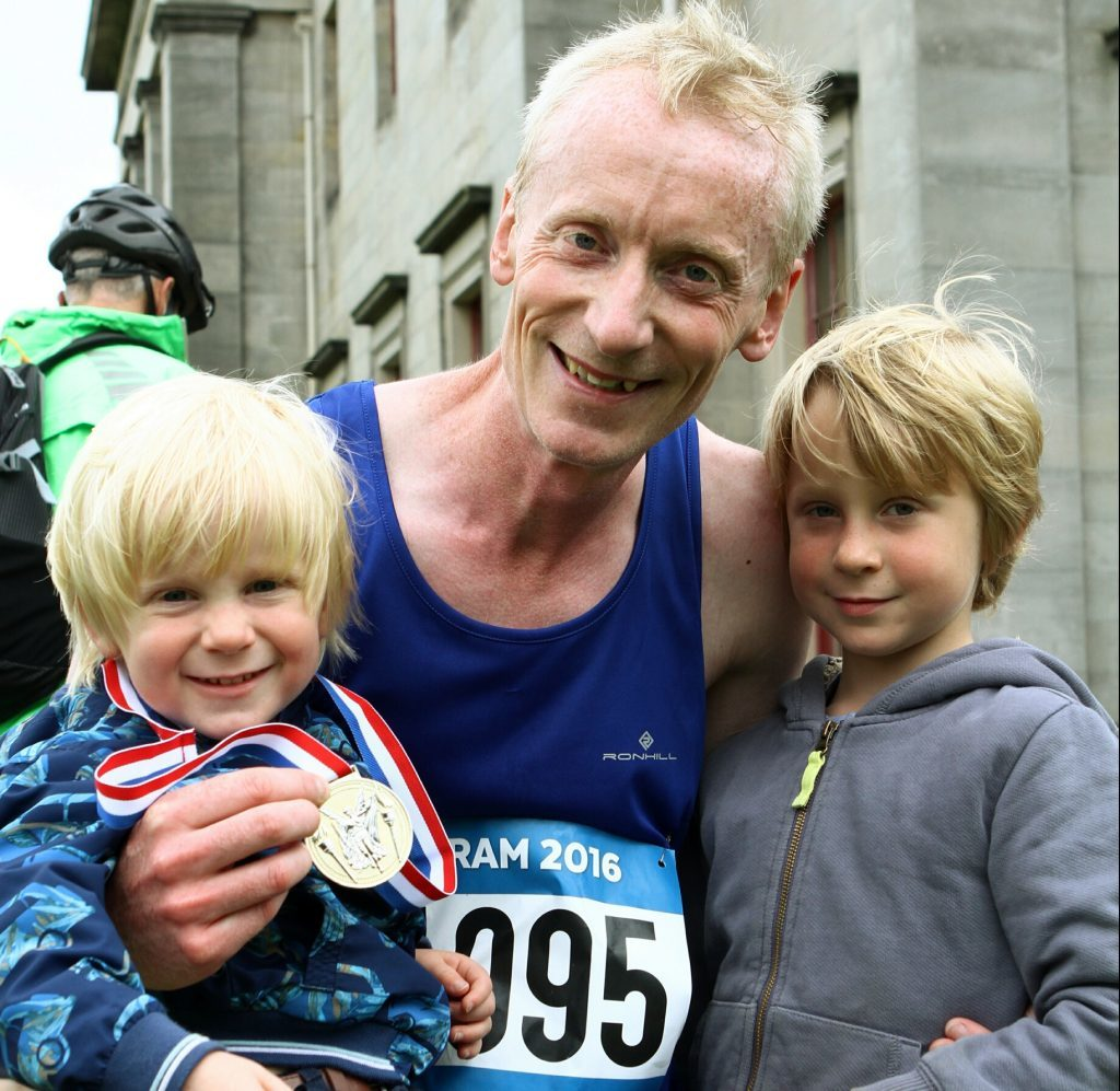 David Henderson from Dundee with his sons Angus, age 2, and Hamish age 5 in Camperdown Park