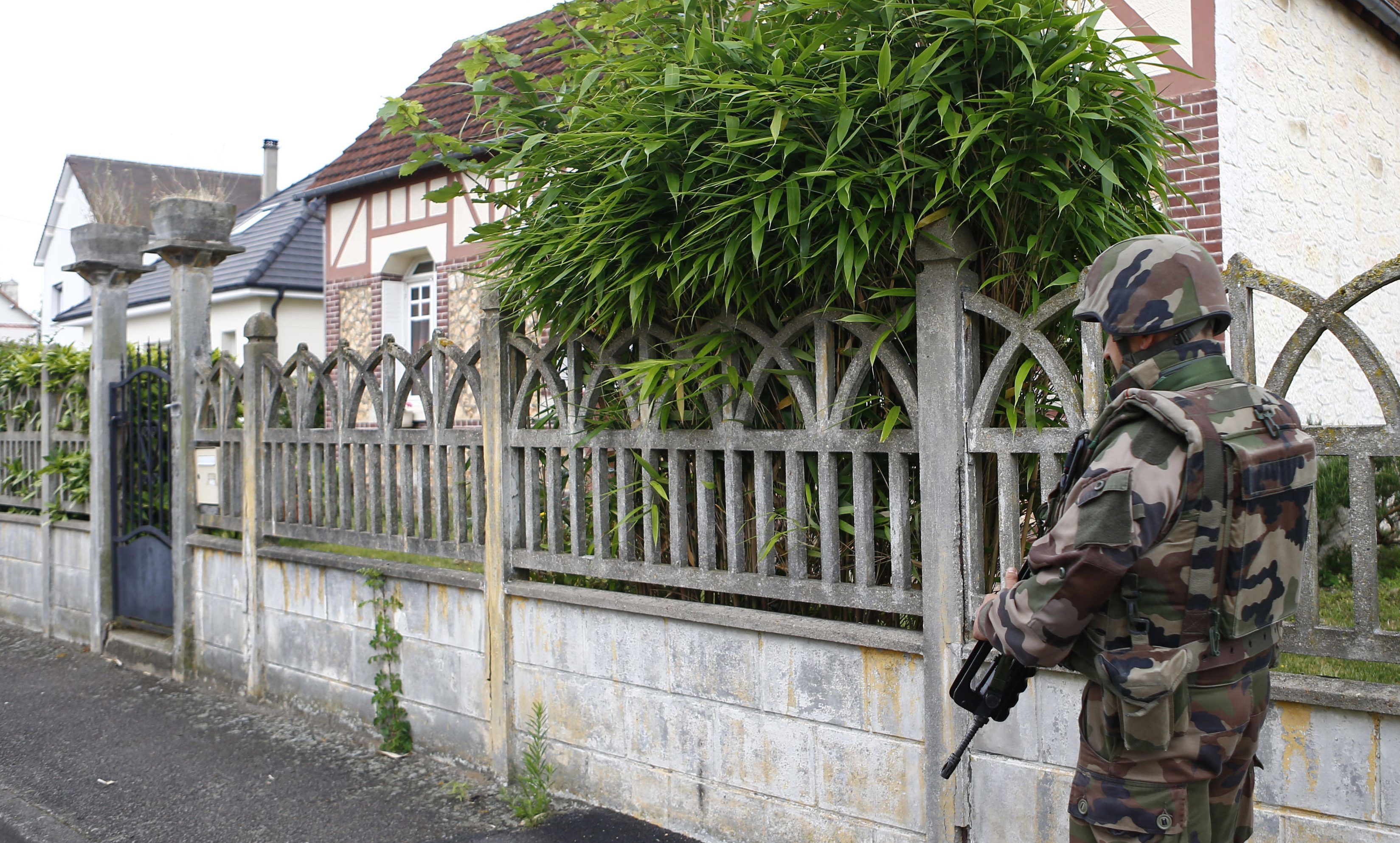 A French soldiers stands guard near the scene of the church terror attack in Saint-Etienne-du-Rouvray, Normandy.
