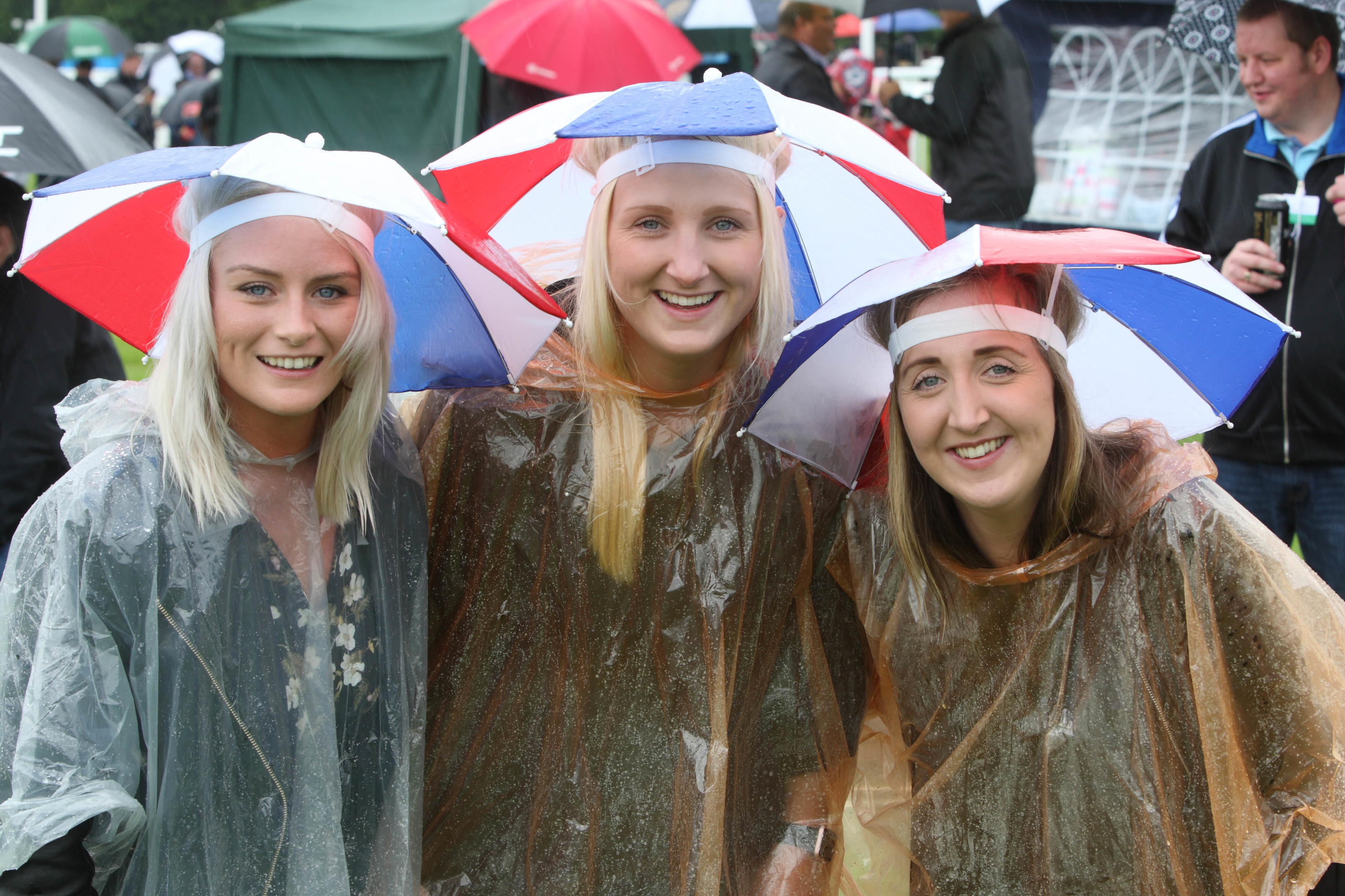 Lauren Stewart Laura Mutch and Rachel Mutch , from Aberdeen were ready for the rain.