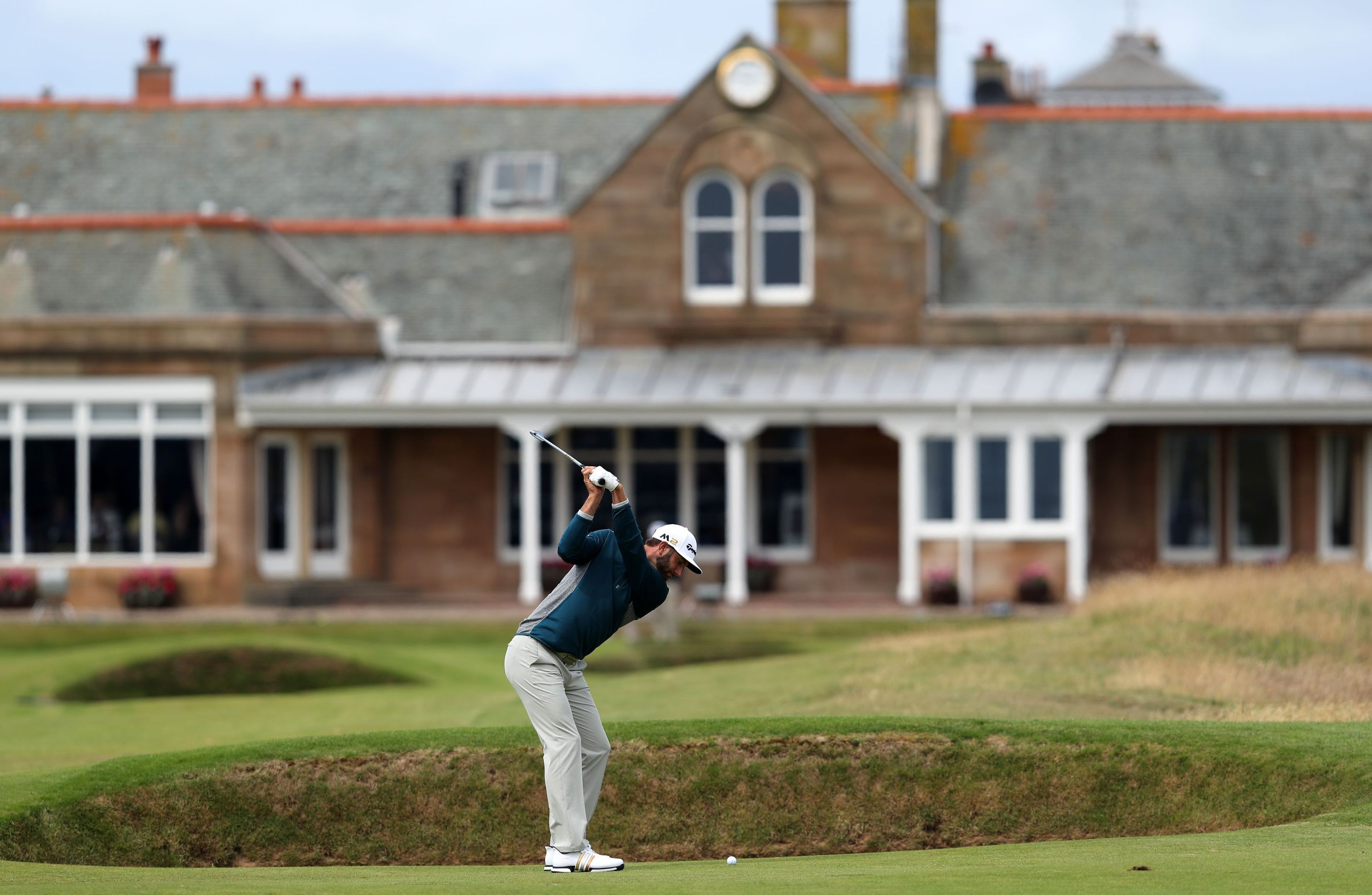 Dustin Johnson hits to the 18th green in practice at Royal Troon.