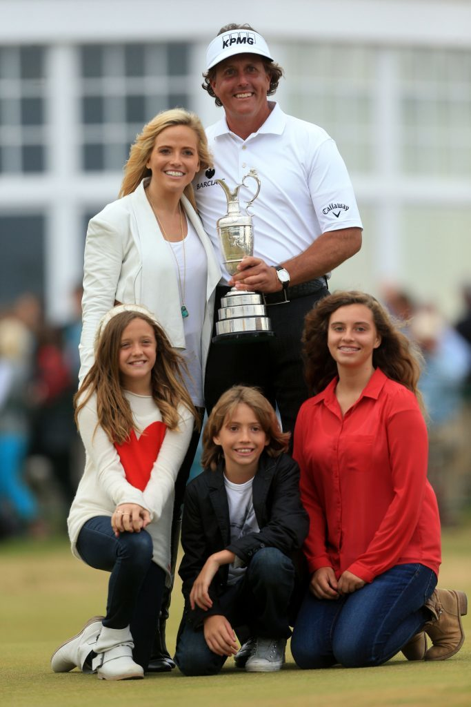 USA's Phil Mickelson celebrates with the Claret Jug and his family after winning the 2013 Open Championship at Muirfield Golf Club.