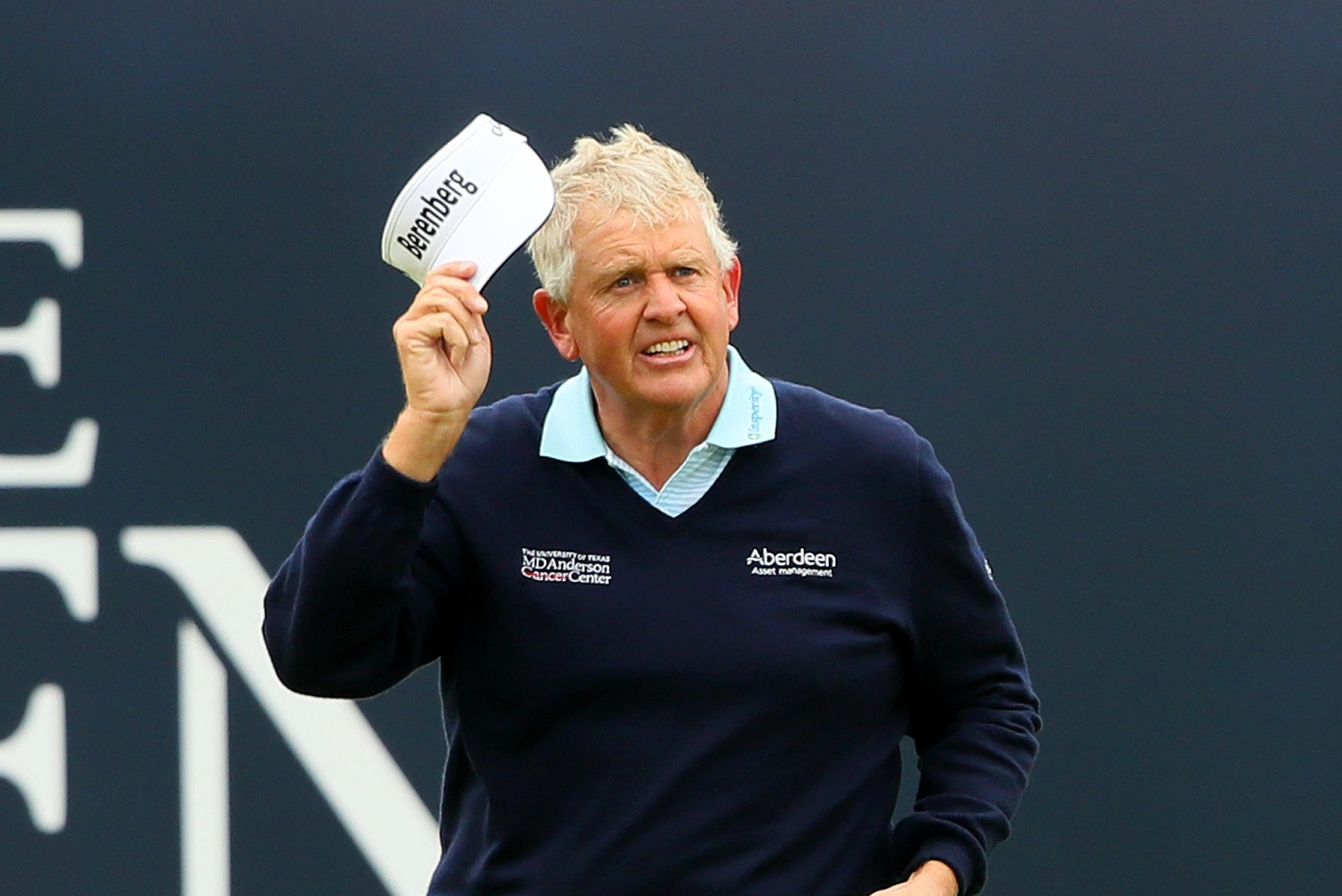 Colin Montgomerie of acknowledges the crowd on the 18th green.
