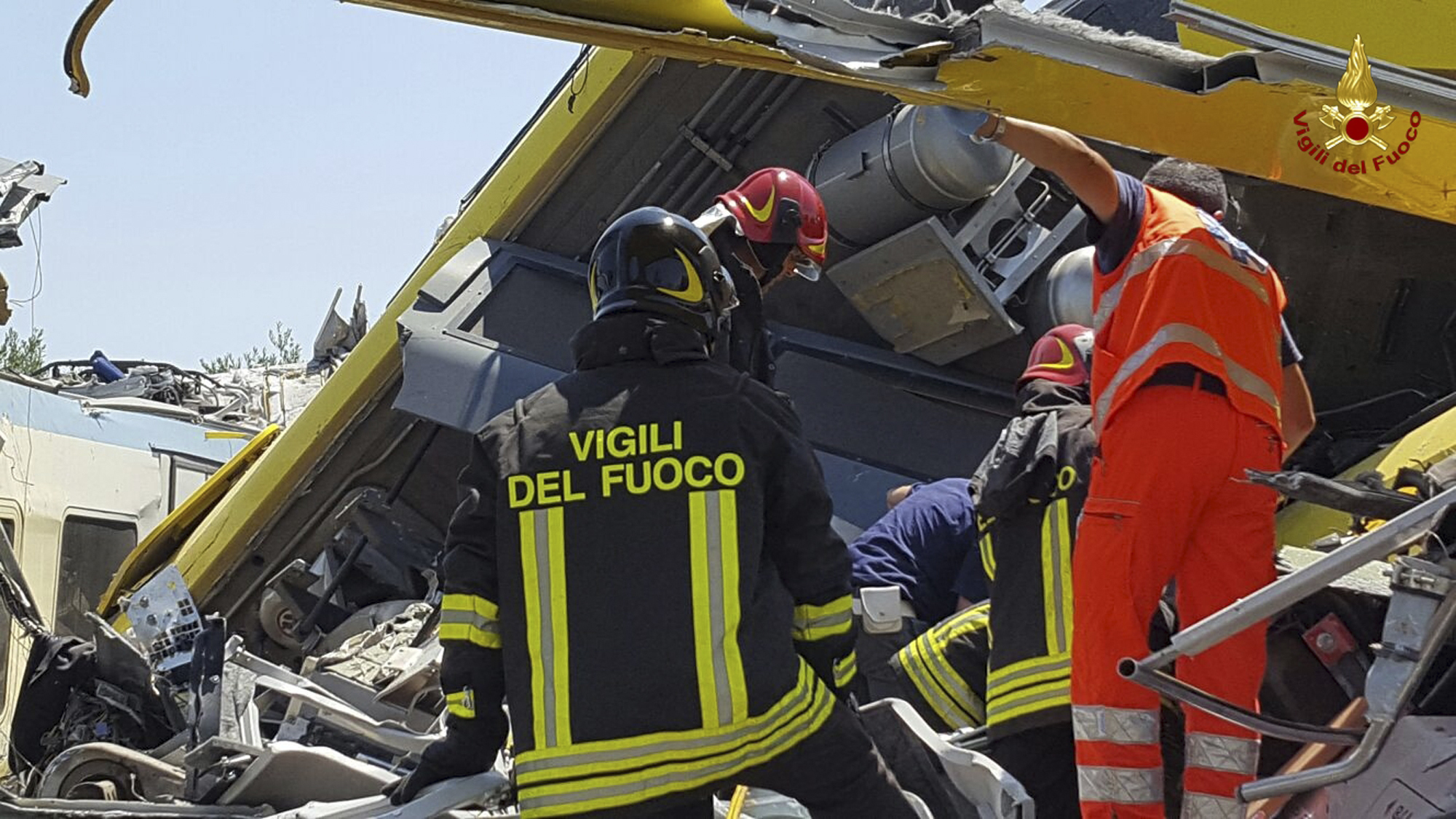 Italian firefighters  inspect the wreckage.