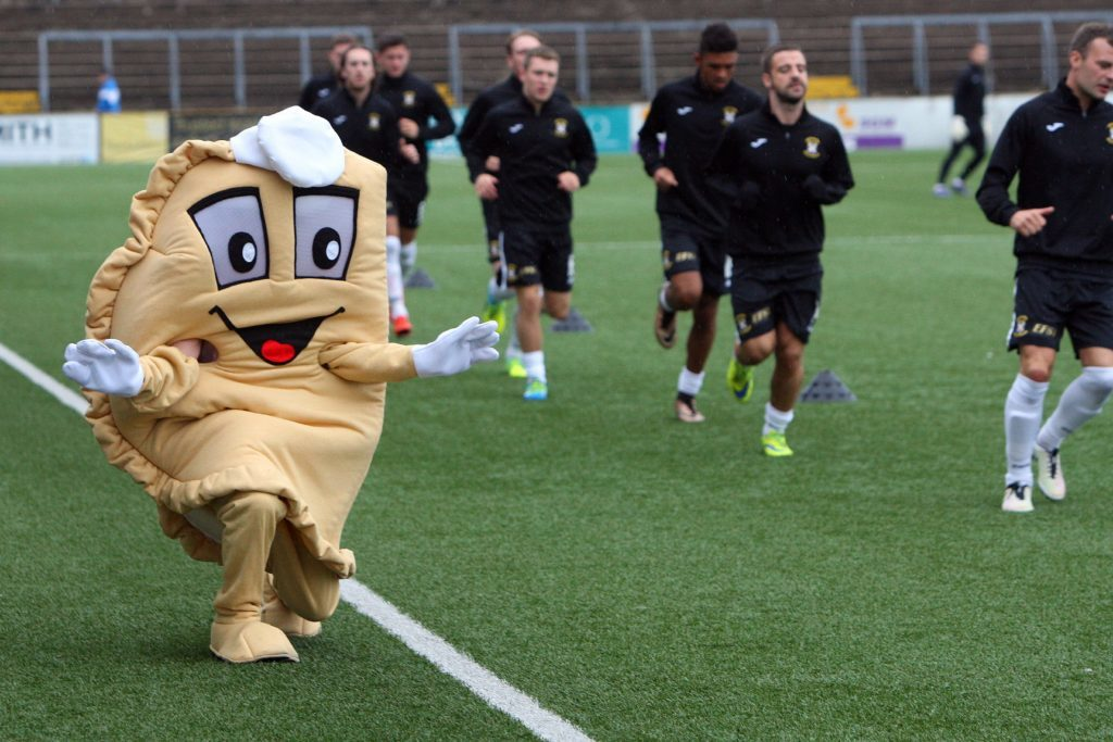 Baxter warms up with East Fife players.