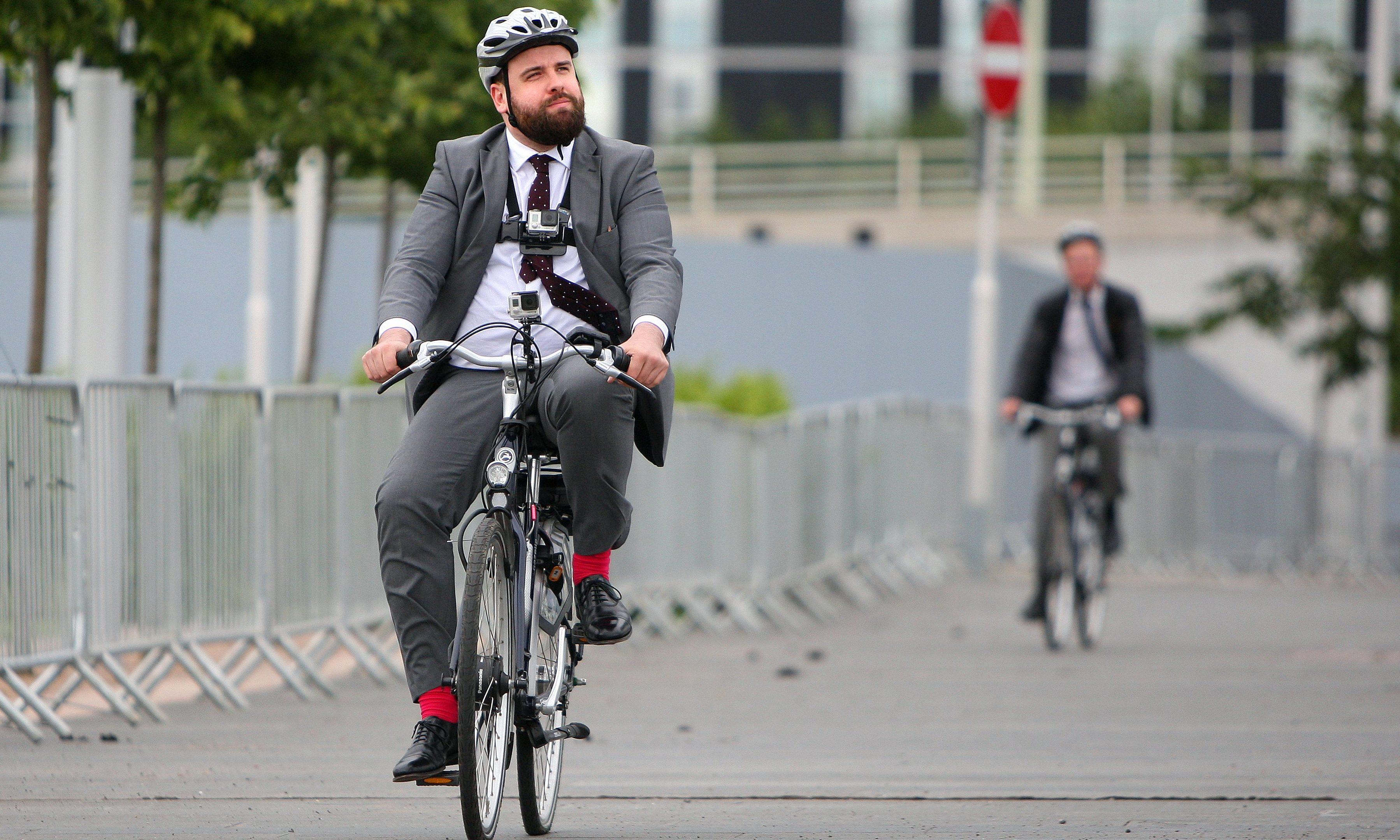 Reporter Paul Malik trying out an electric bike