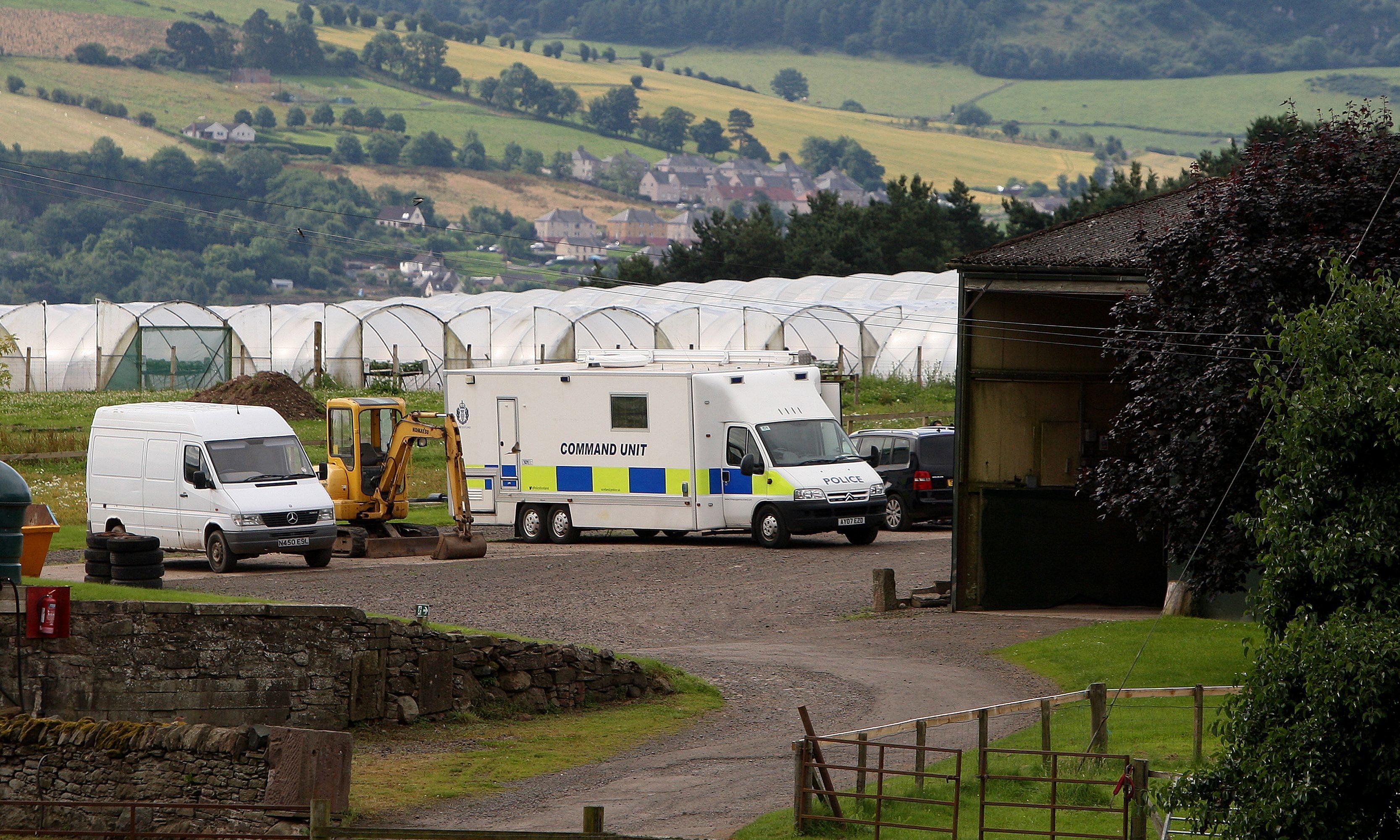 Police at Mains of Errol farm on Sunday.