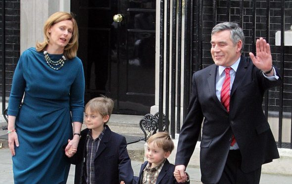 Gordon and Sarah Brown leave Downing Street with sons John and Fraser.
