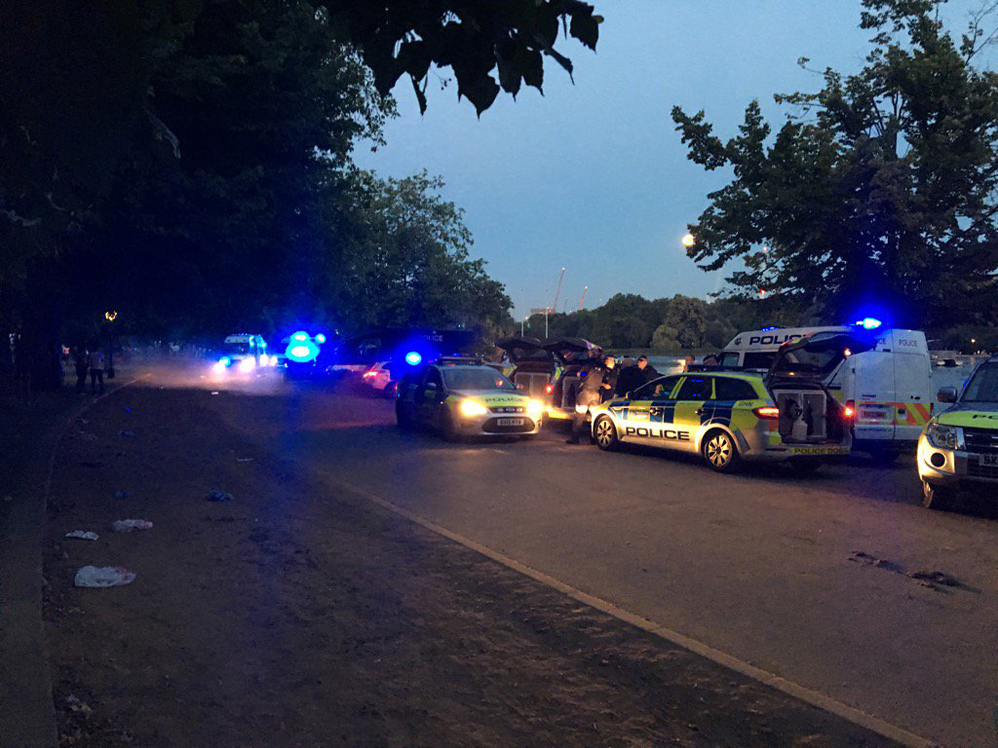 Scotland Yard said one officer was stabbed and another was injured by a bottle when the spontaneous water fight by the Serpentine in London's Hyde Park became hostile at about 8.40pm.