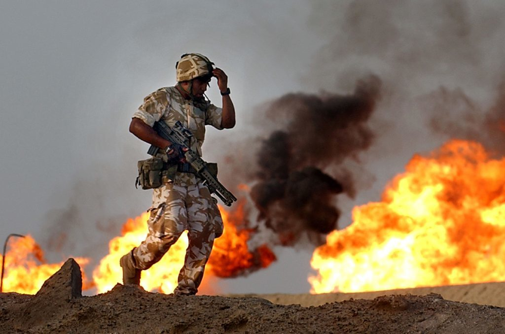 Troops from the 2nd Battalion Light Infantry during an evening patrol targeting oil smugglers at a gas and oil separation plant in Rauallah, Southern Iraq.