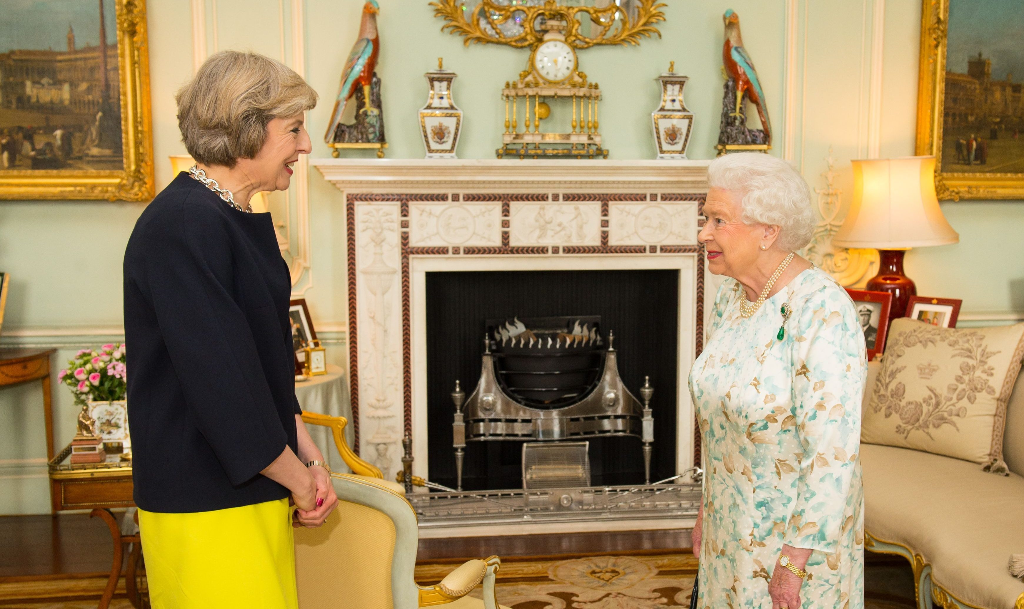 Queen Elizabeth II welcomes Theresa May at the start of an audience in Buckingham Palace in which she invited the former Home Secretary to form a government