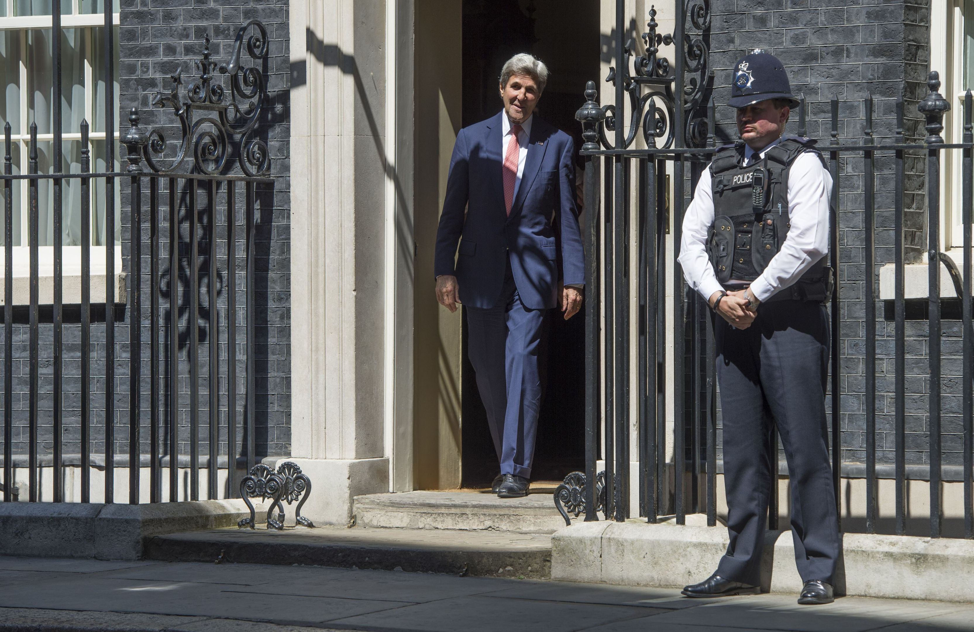 US Secretary of State John Kerry leaves 10 Downing Street.