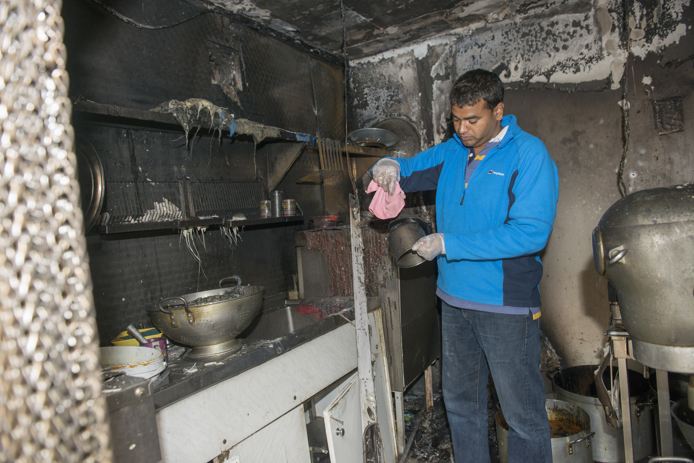 Owner Praveen Kumar pictured inside the fire damaged kitchen at Tabla Perth today.