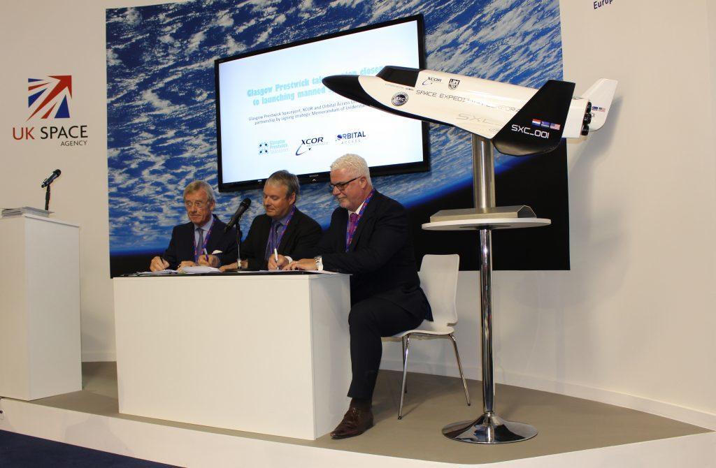 Strategic adviser Bem Droste, Stuart McInytre, Orbital Access CEO, and Mike Stewart, business development director at Glasgow Prestwick Spaceport, signing the memorandum of understanding.