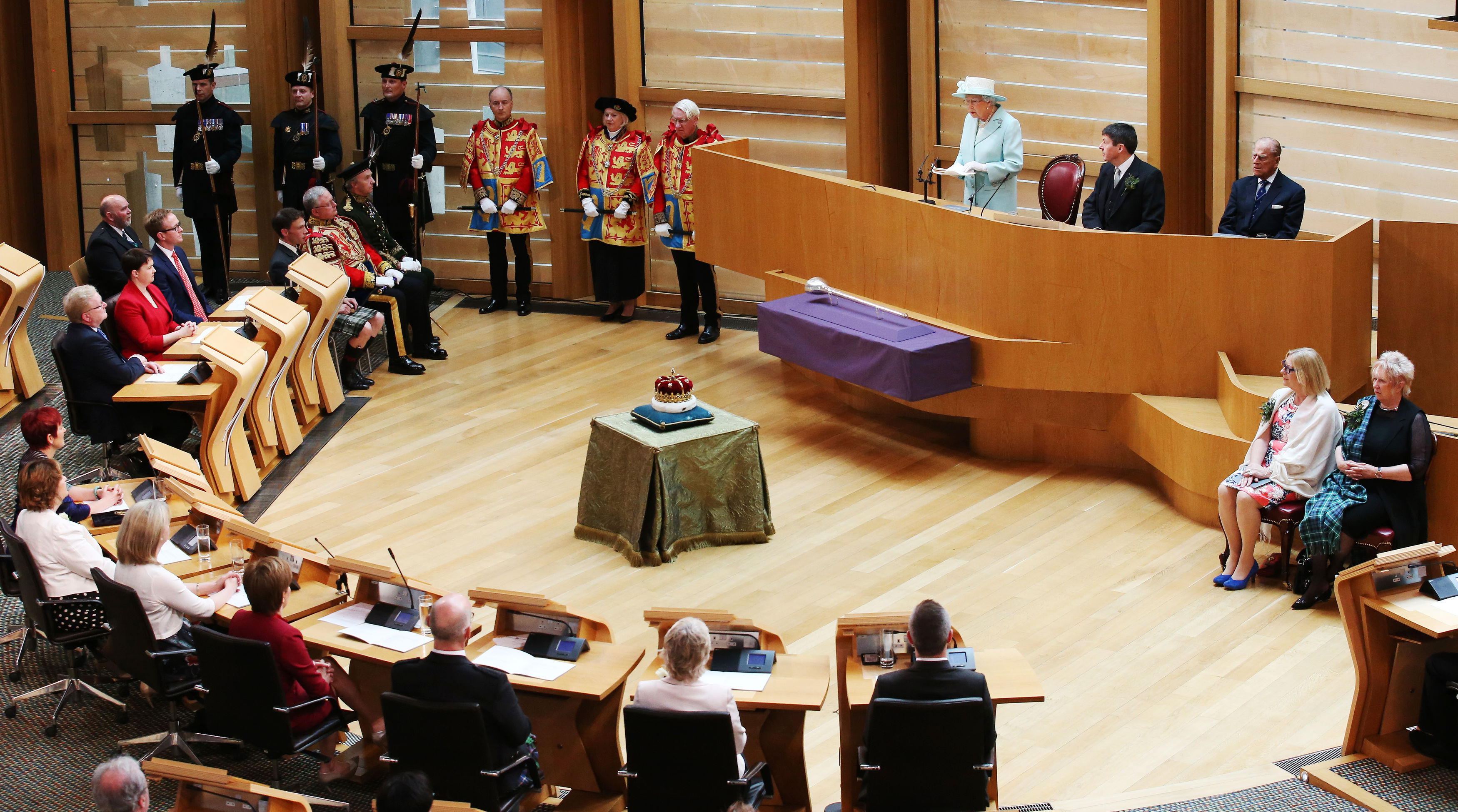 The Queen speaks as Presiding Officer Ken Macintosh and the Duke of Edinburgh listen during the opening of the fifth session of the Scottish Parliament in Edinburgh.