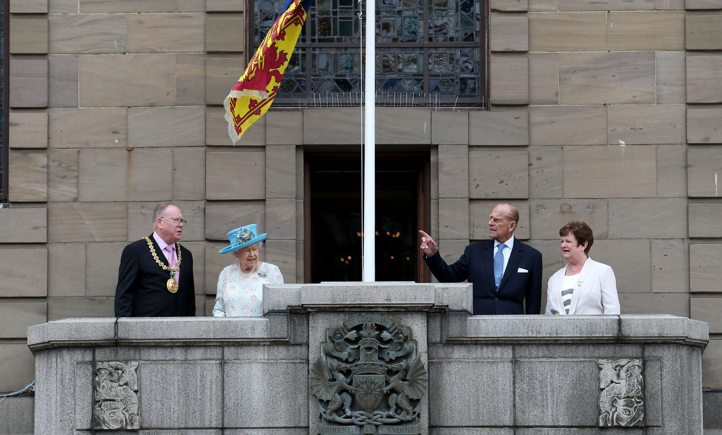 The Queen and the Duke of Edinburgh appear on the balcony of Dundee City Chambers with Lord Provost Bob Duncan (left) and his wife Brenda (right).