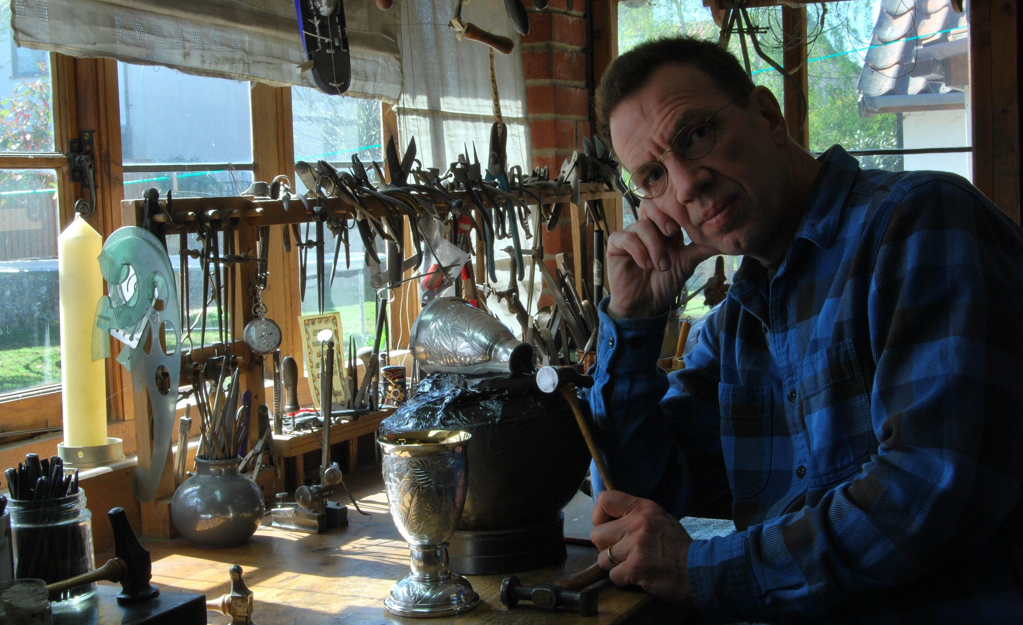Silversmith Rod Kelly in his workshop