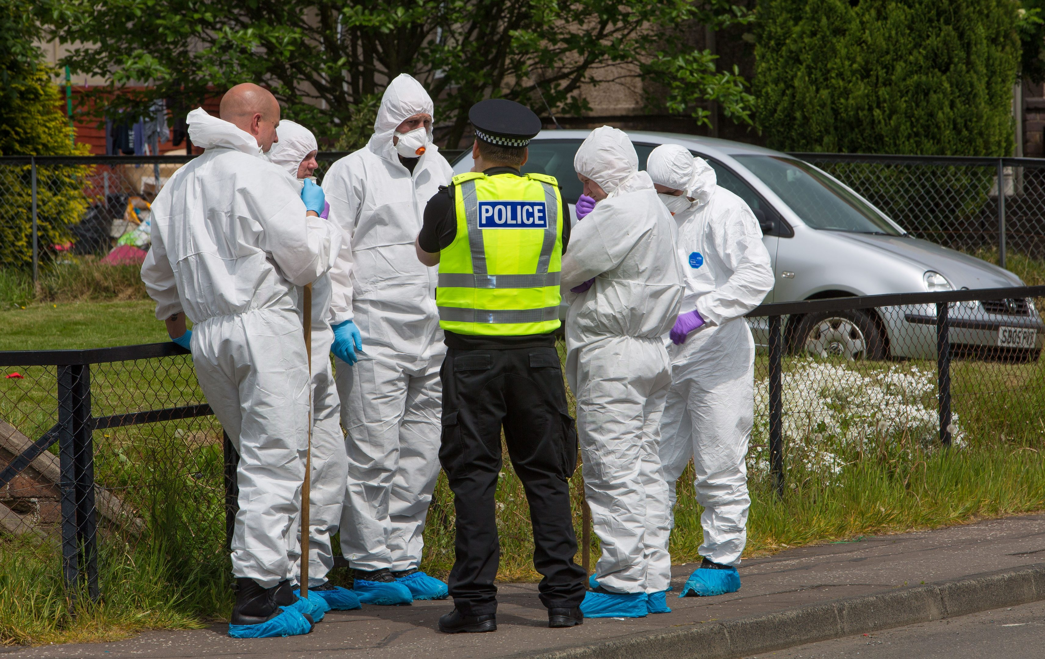 Forensic officers were prominent in the initial searches around Tweed Avenue in Kirkcaldy where Darren Adie was discovered.