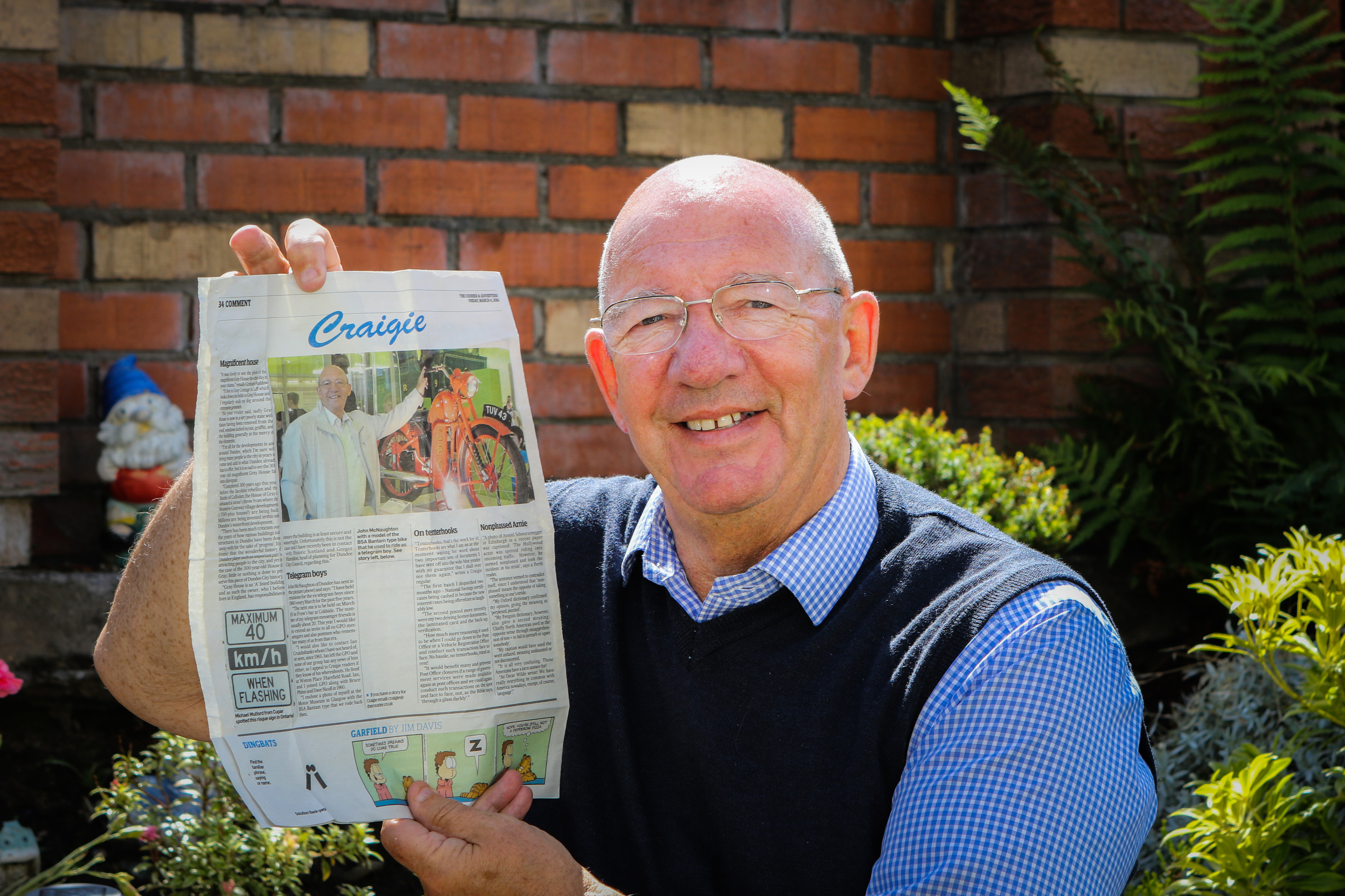 John McNaughton with the article that led to the reunion.