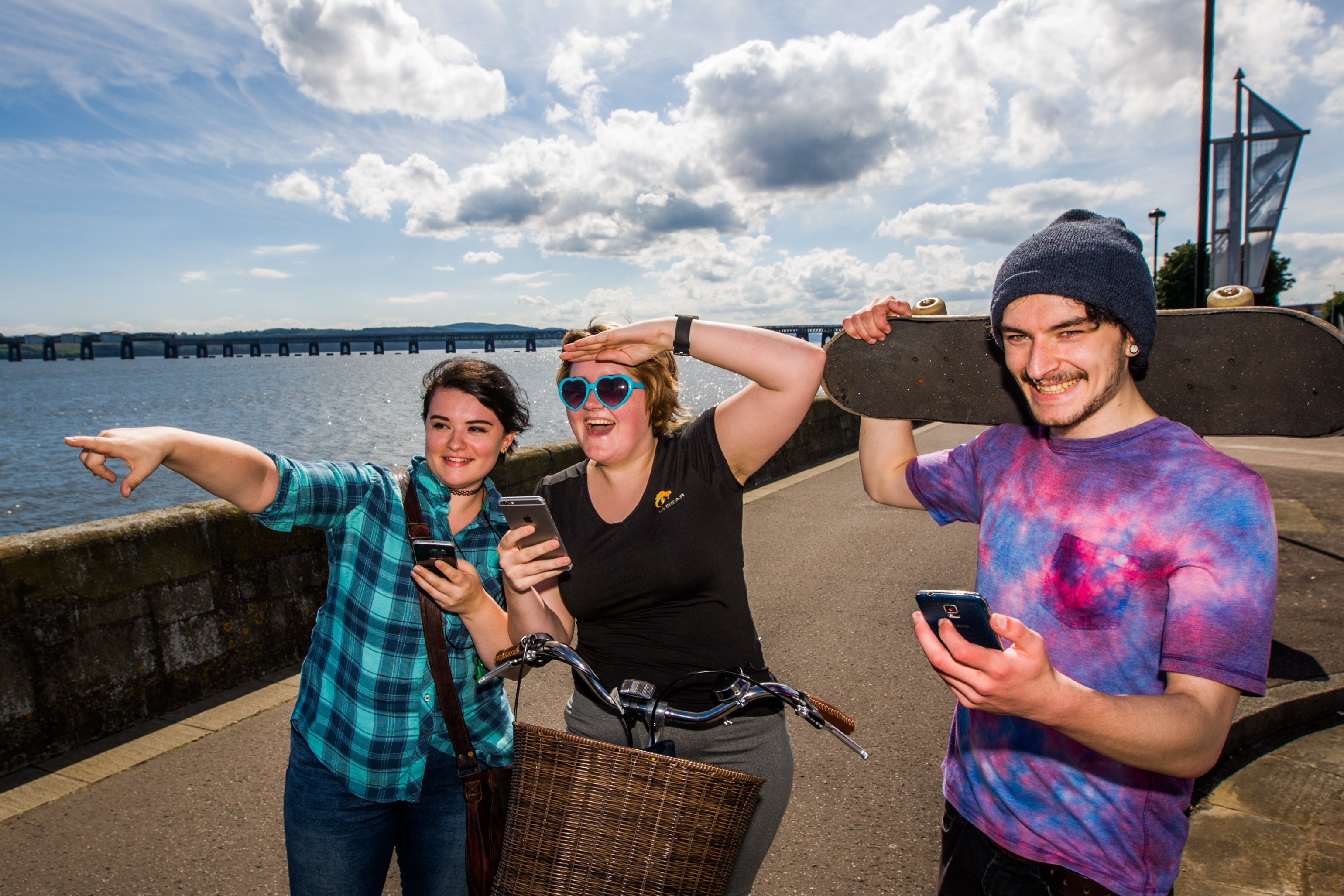 Dundonians have been chasing Pokemon all over the city since the launch of Pokemon Go. Picture shows left to right, Sarah Sharkie, Keilidh Bradley and Fergus Russell (both studying Animation at DJCAD) playing the Pokemon Go app on their phones at Riverside Dundee.