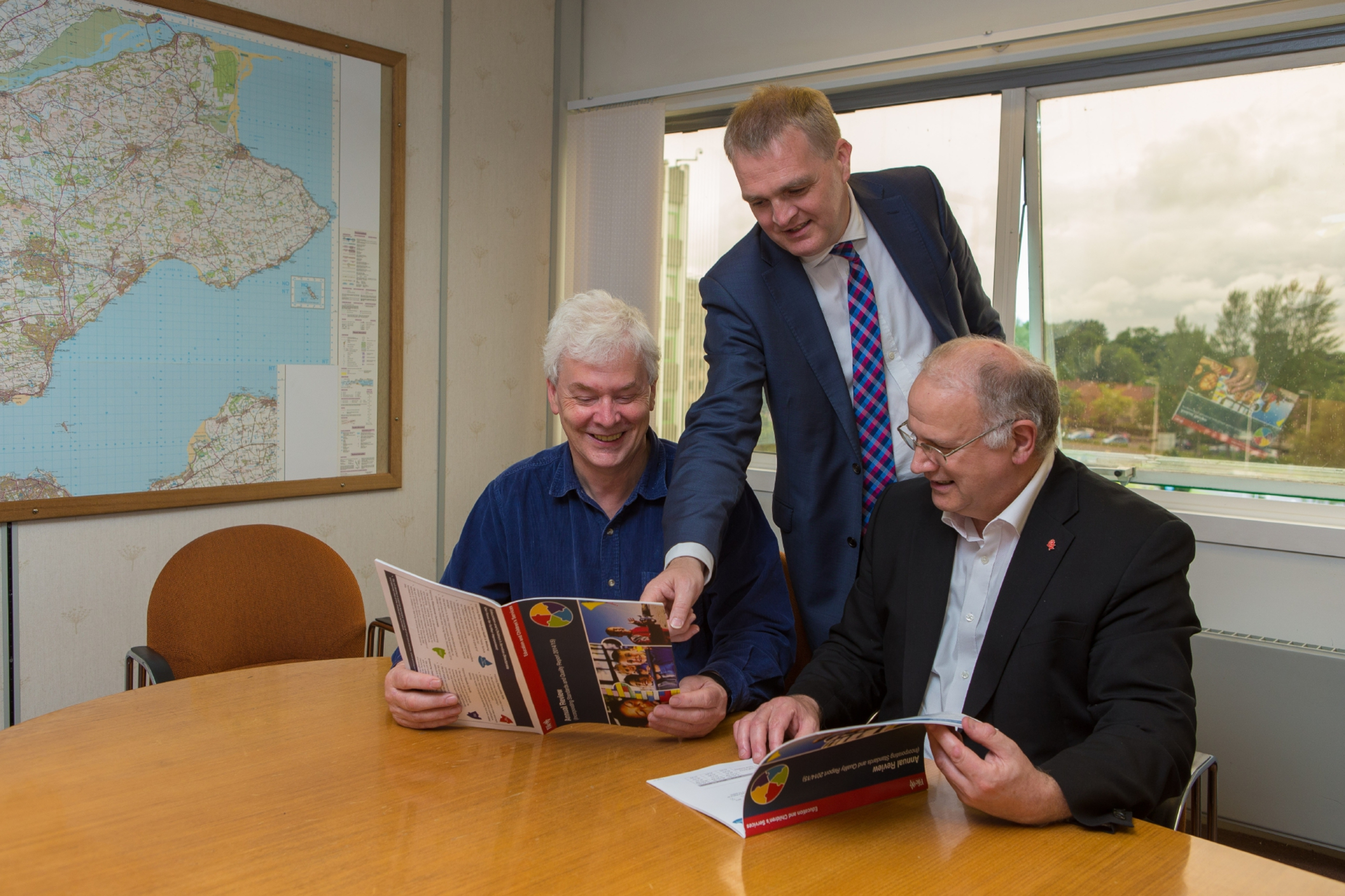 Fife Council's executive director of childrens services, Craig Munro (standing), and children's services spokesman Councillor Bryan Poole (left) along with leader of FIfe Council Cllr David Ross (right).