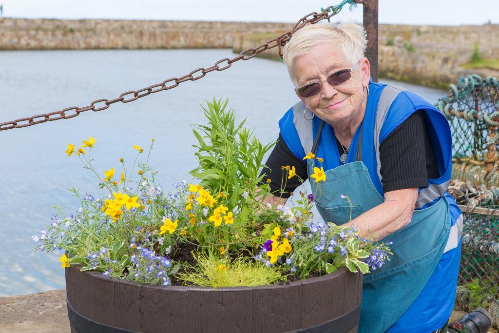 Marysia Denyer of St Andrews in Bloom is all smiles at the harbour