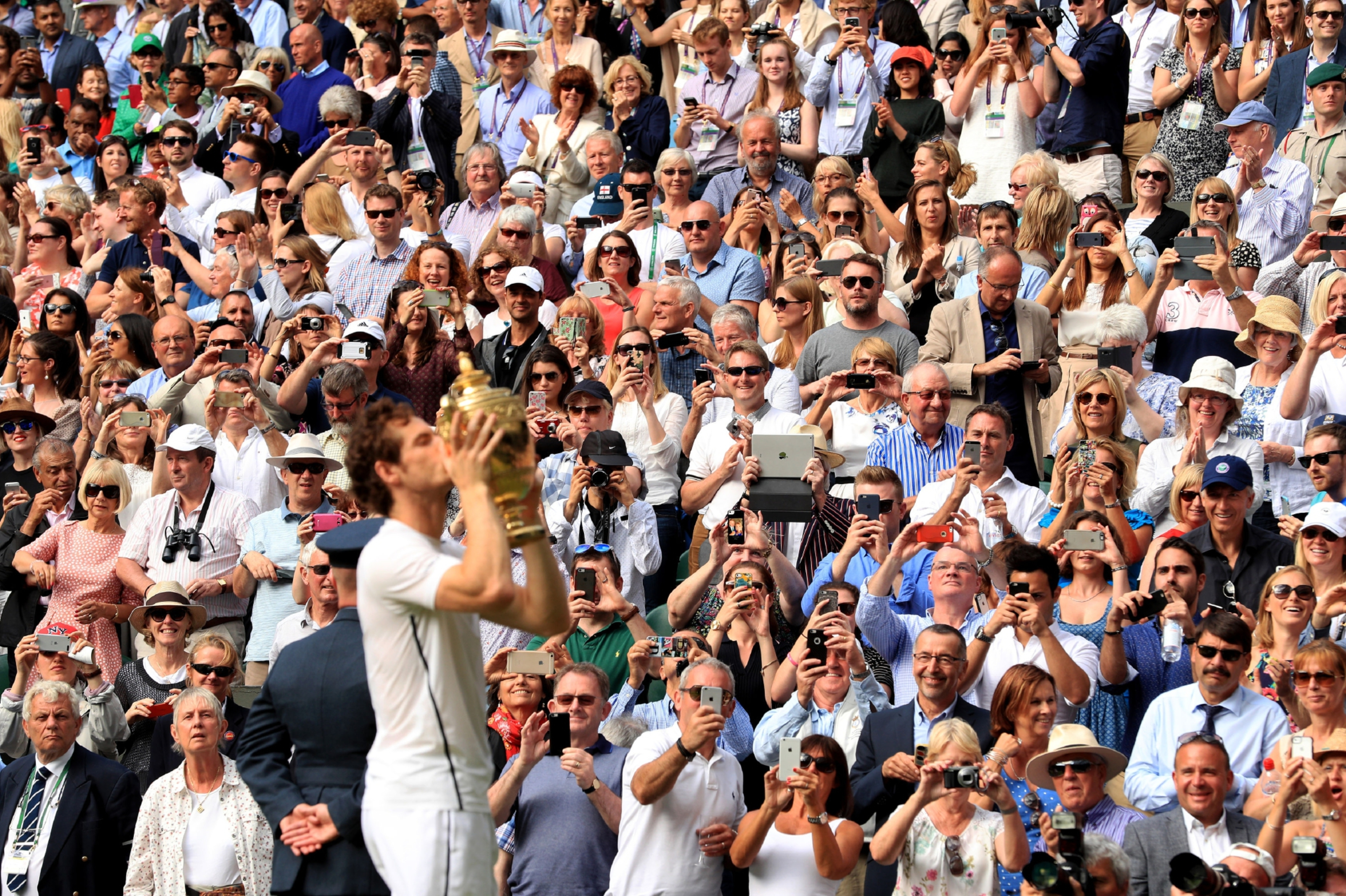 A champion again — Andy Murray gets reacquainted with the Wilmbledon trophy.