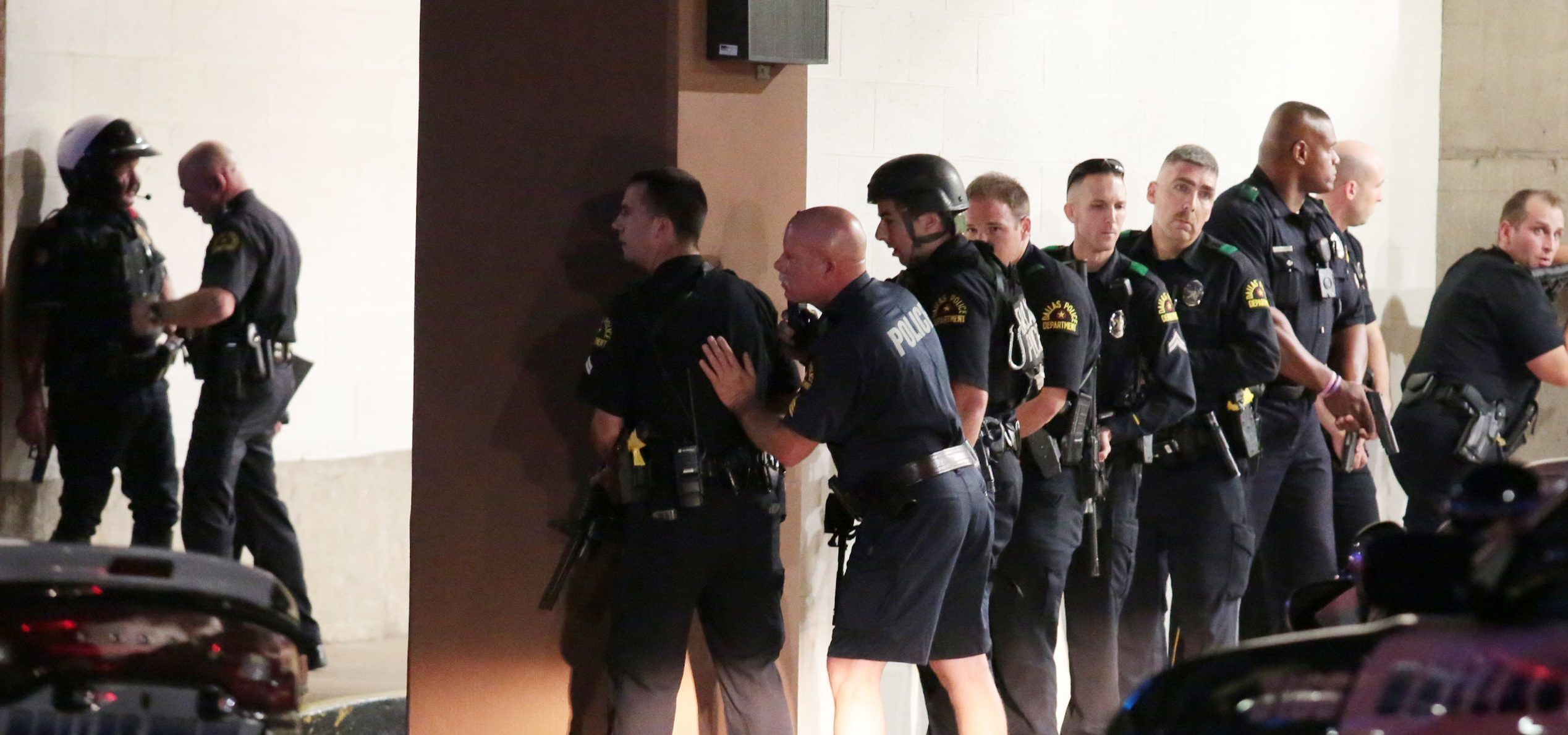 Police take cover after shots were fired.