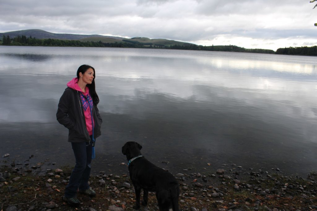 Gayle and Toby enjoy the view across Loch of Lintrathen after a night's camping.