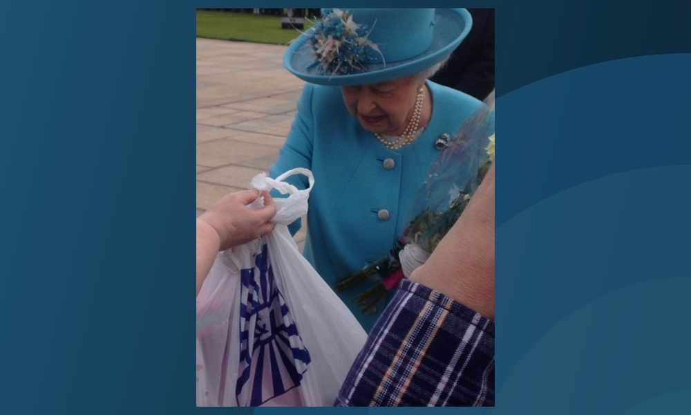 The Queen receives her unusual gift during Wednesday's royal event at Slessor Gardens in Dundee.