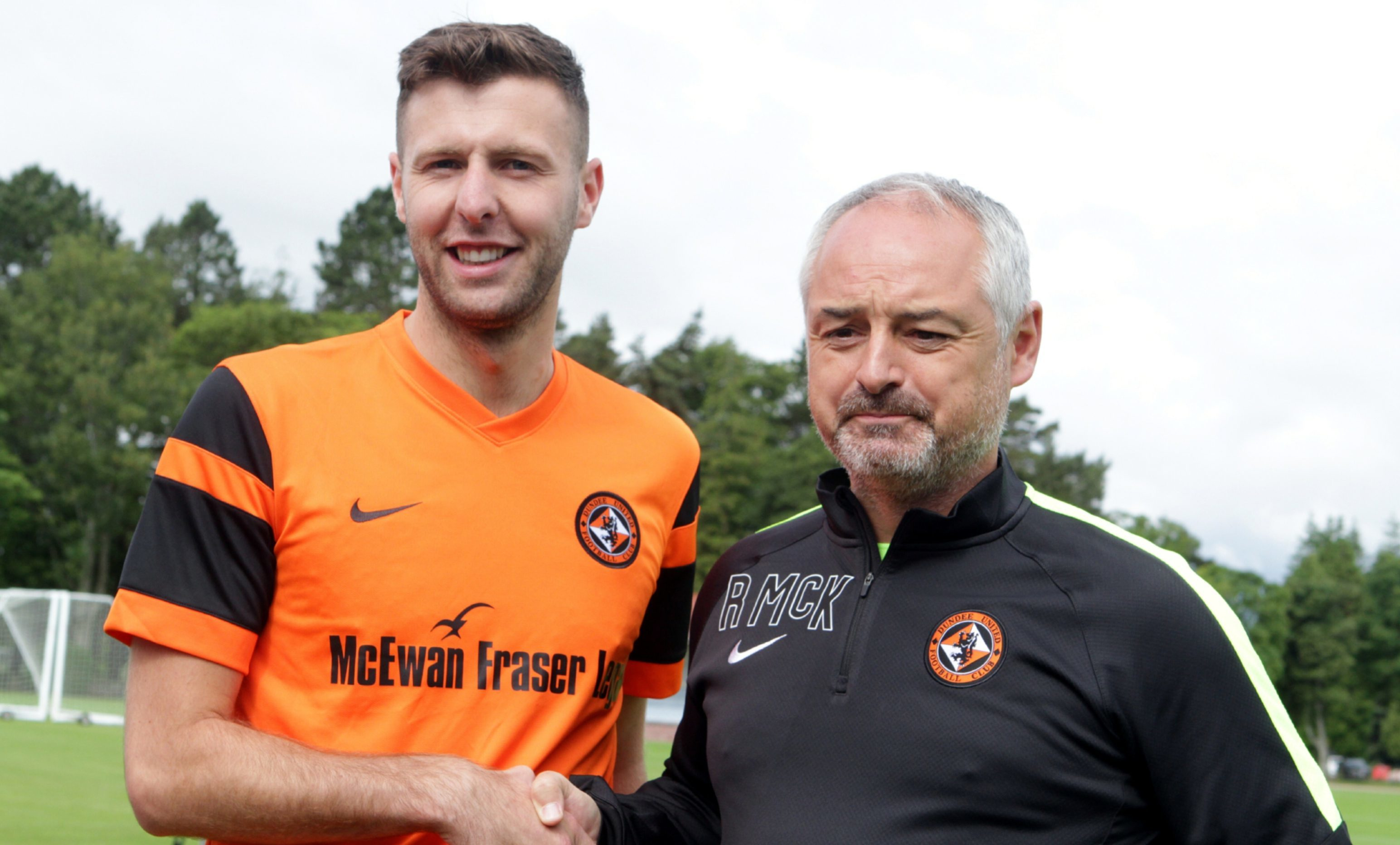 Lewis Toshney with manager Ray McKinnon.