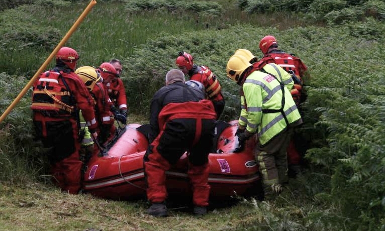 Firefighters helped in the rescue attempt.