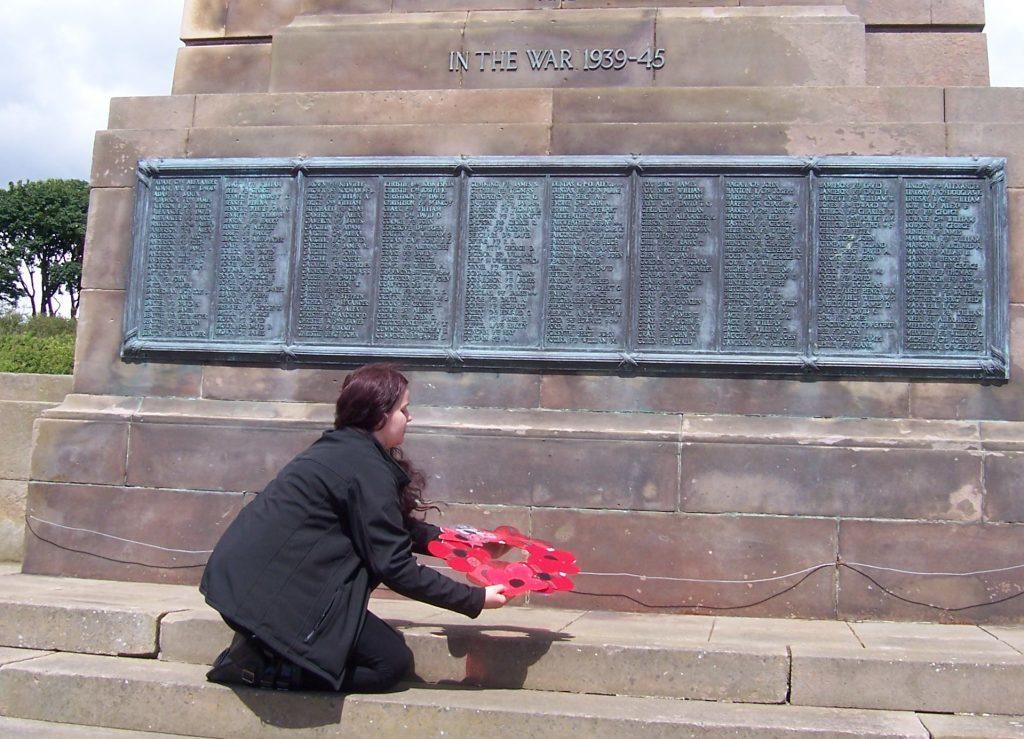 Signal Tower Museum's Lucia Wallbank laying the handmade poppy wreath at Arbroath War Memorial