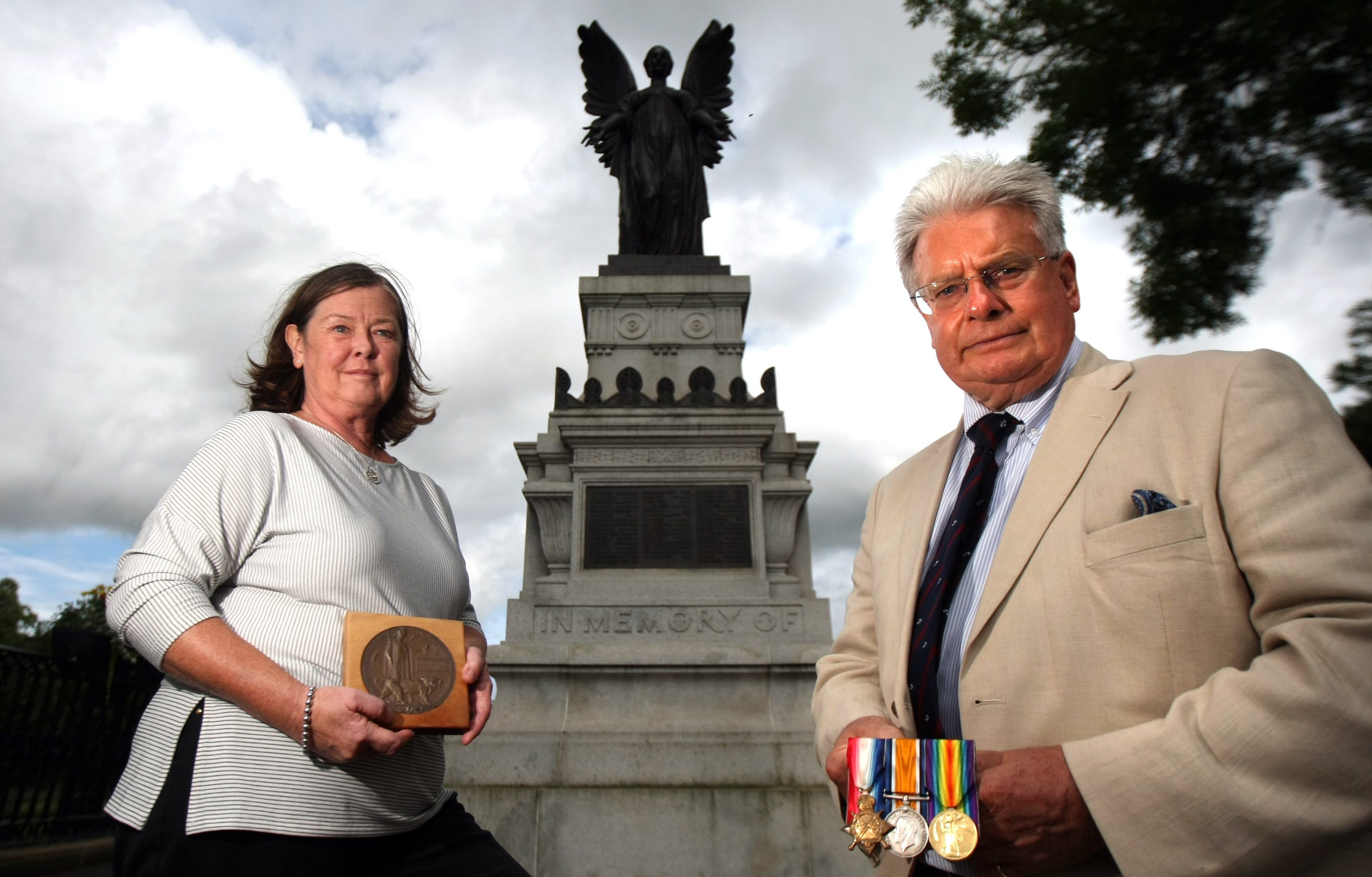 Gilli and Bill Pagan with George Hair Pagan's Dead Man's Penny and his medals in front of Cupar War Memorial