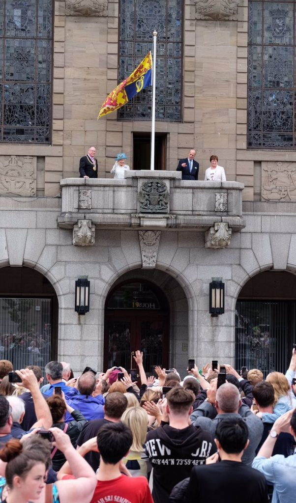 The royals wave from the balcony at City Square.