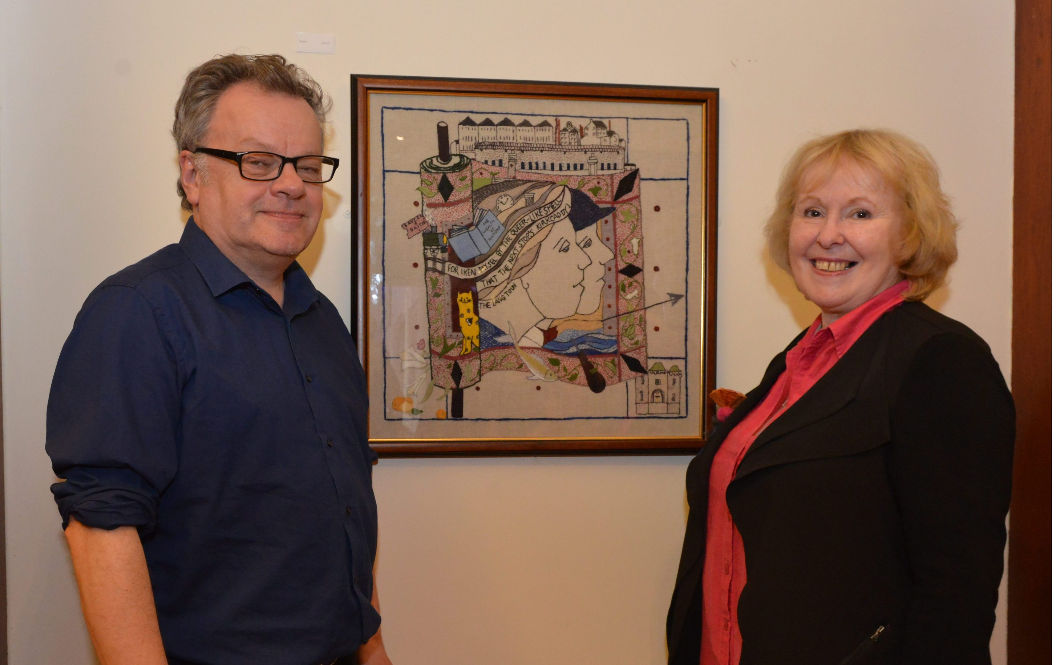 Andrew Crummy and Dorie Wilkie with tapestry.