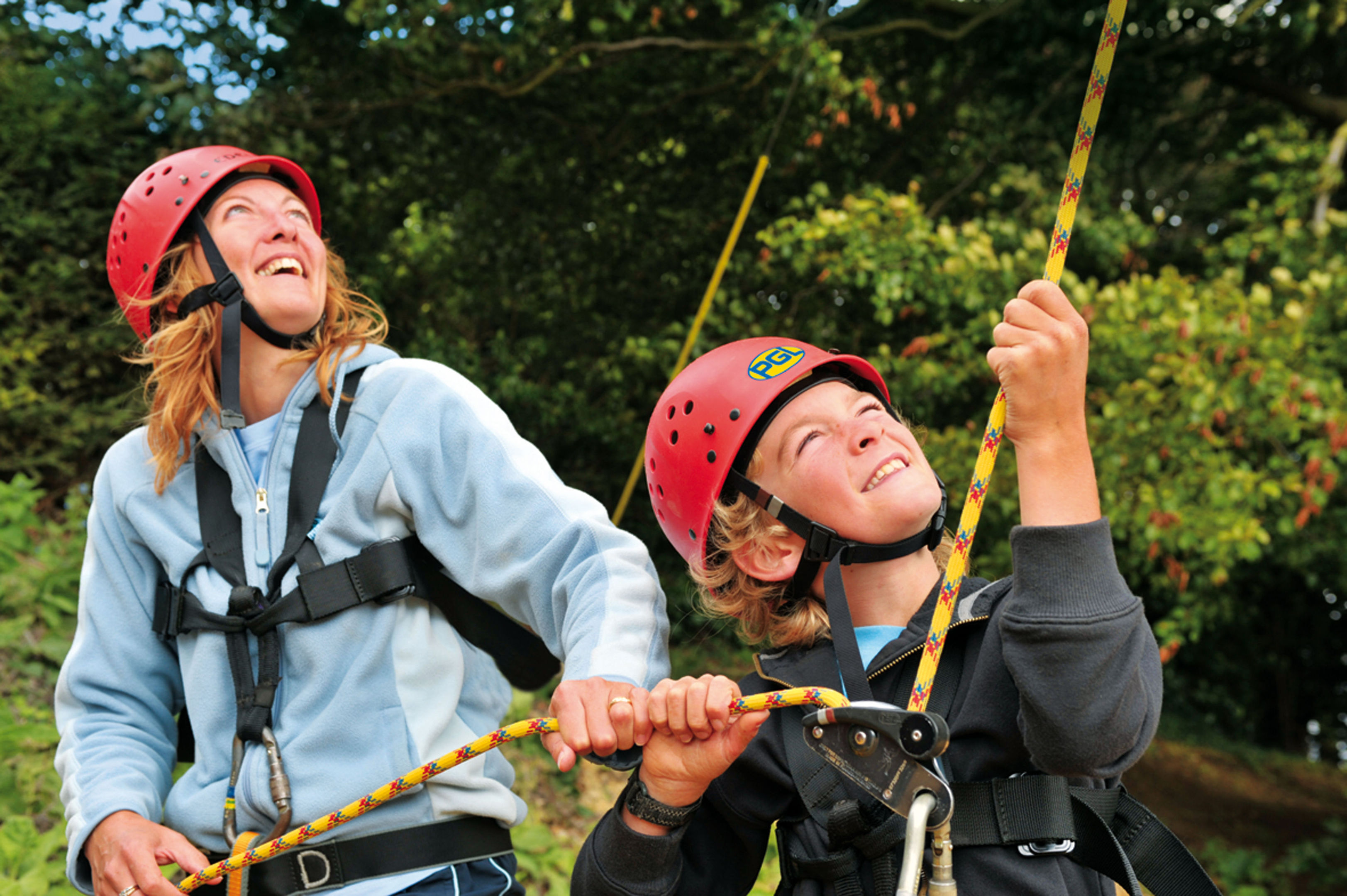 A family abseiling at PGL in Liddington, Wiltshire.