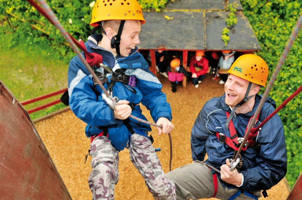 Family abseiling at PGL in Liddington, Wiltshire.