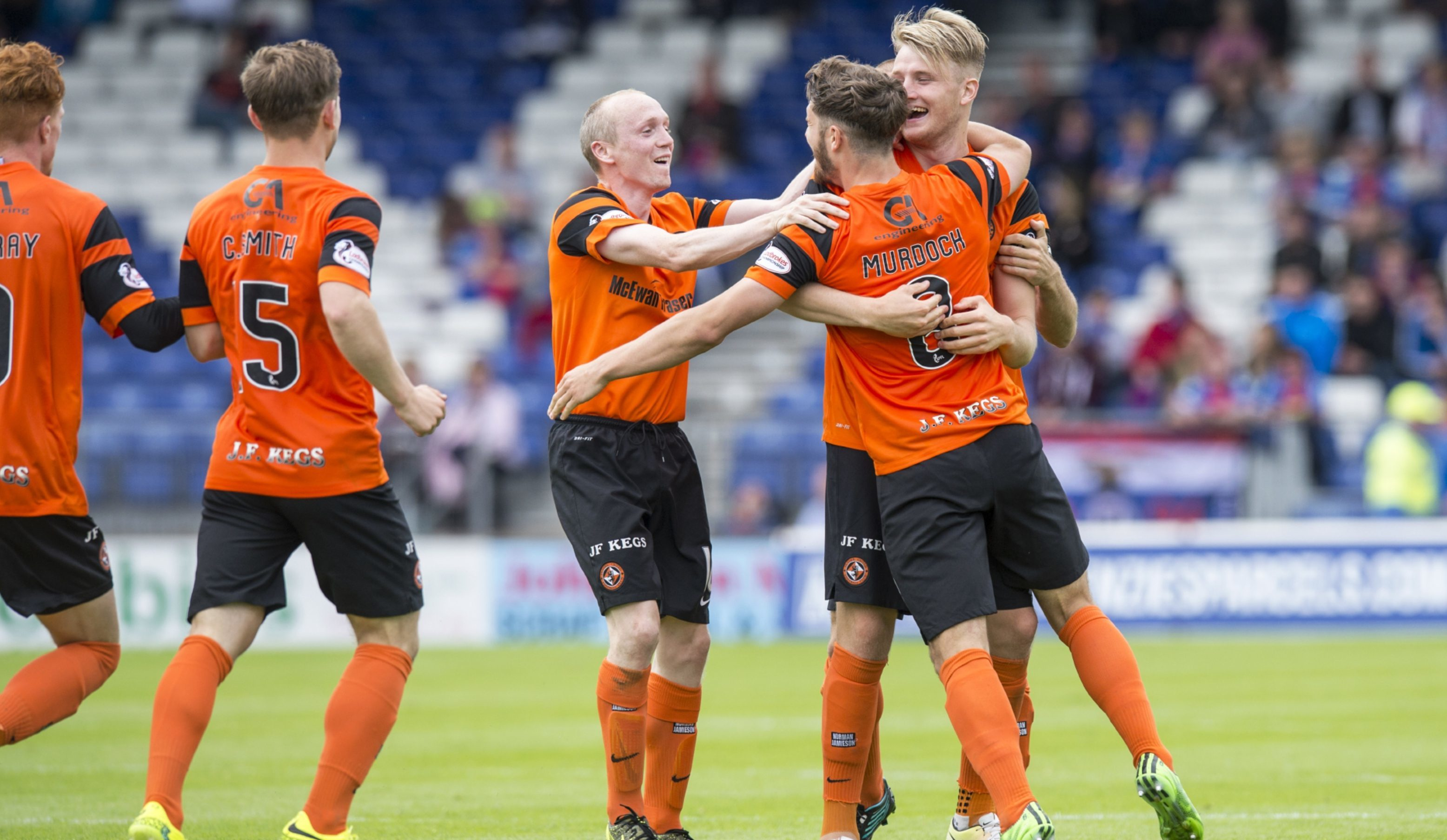 United's players celebrate Stewart Murdoch's goal against Inverness.