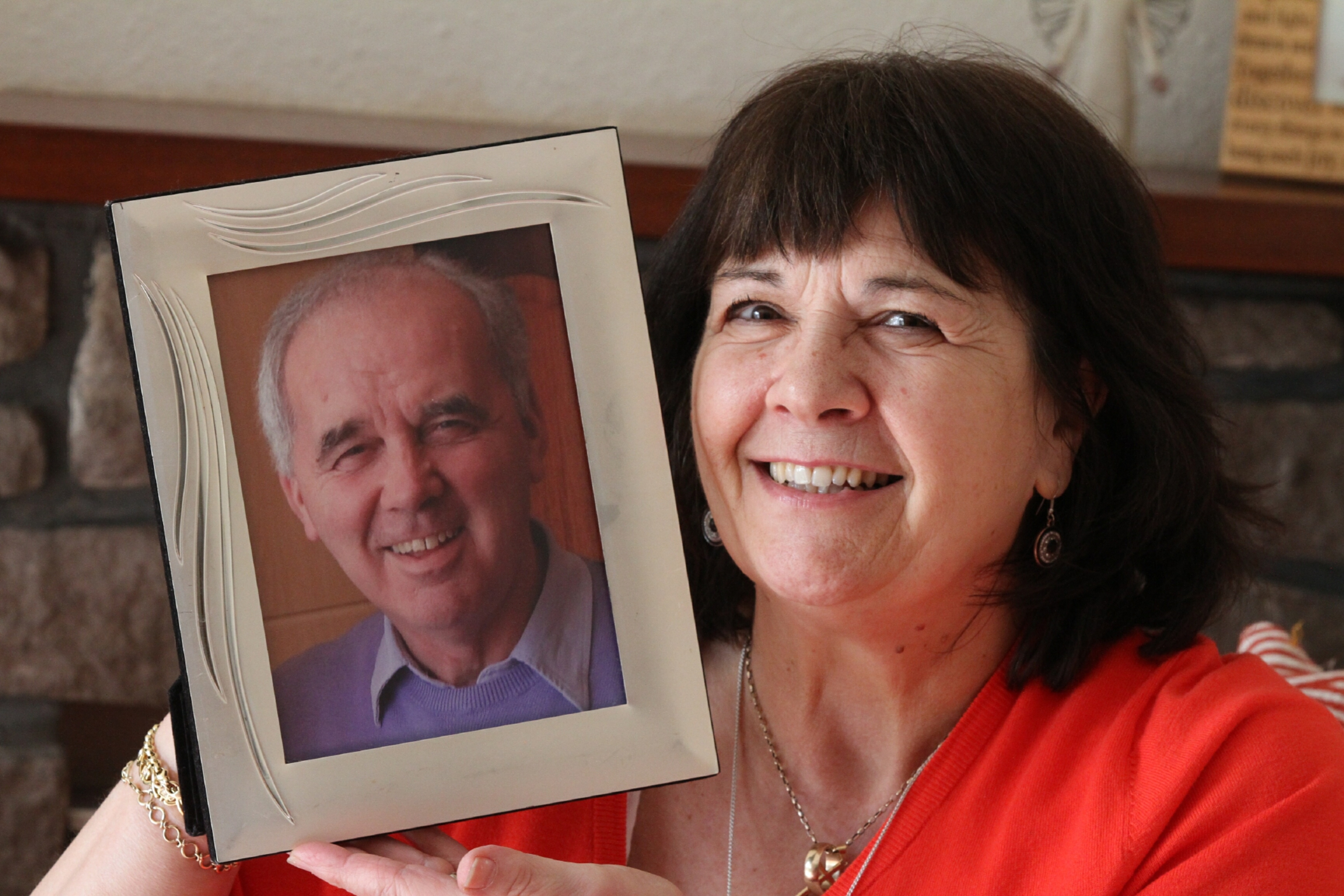 Amanda Kopel with a picture of Frank.