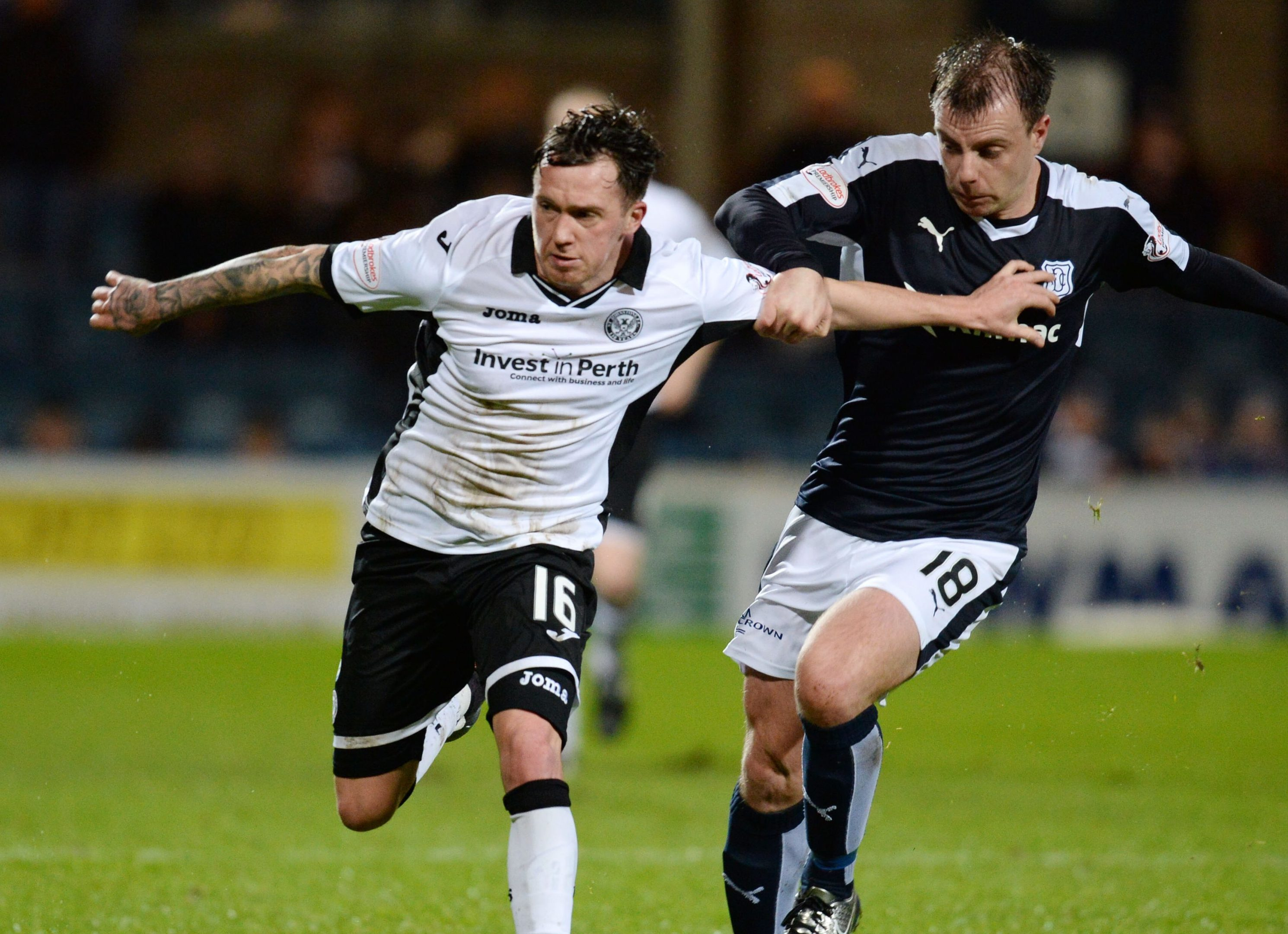 St Johnstone's Danny Swanson battles for the ball against Dundee's Paul McGowan last season.