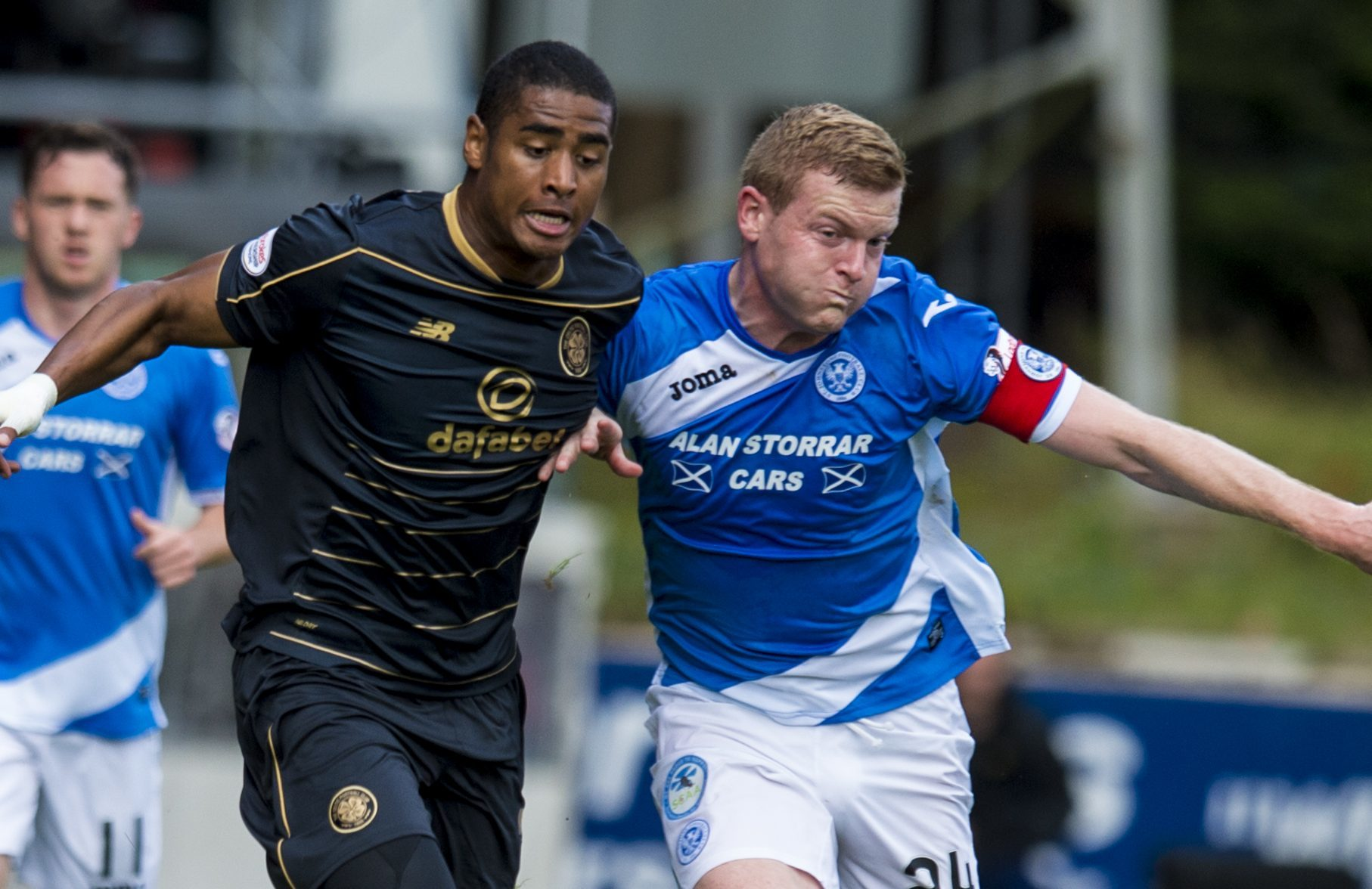 Brian Easton battles for possession with Siady Janko.