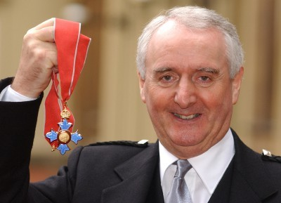 David Will, with the CBE that he was awarded at Buckingham Palace in 2002.