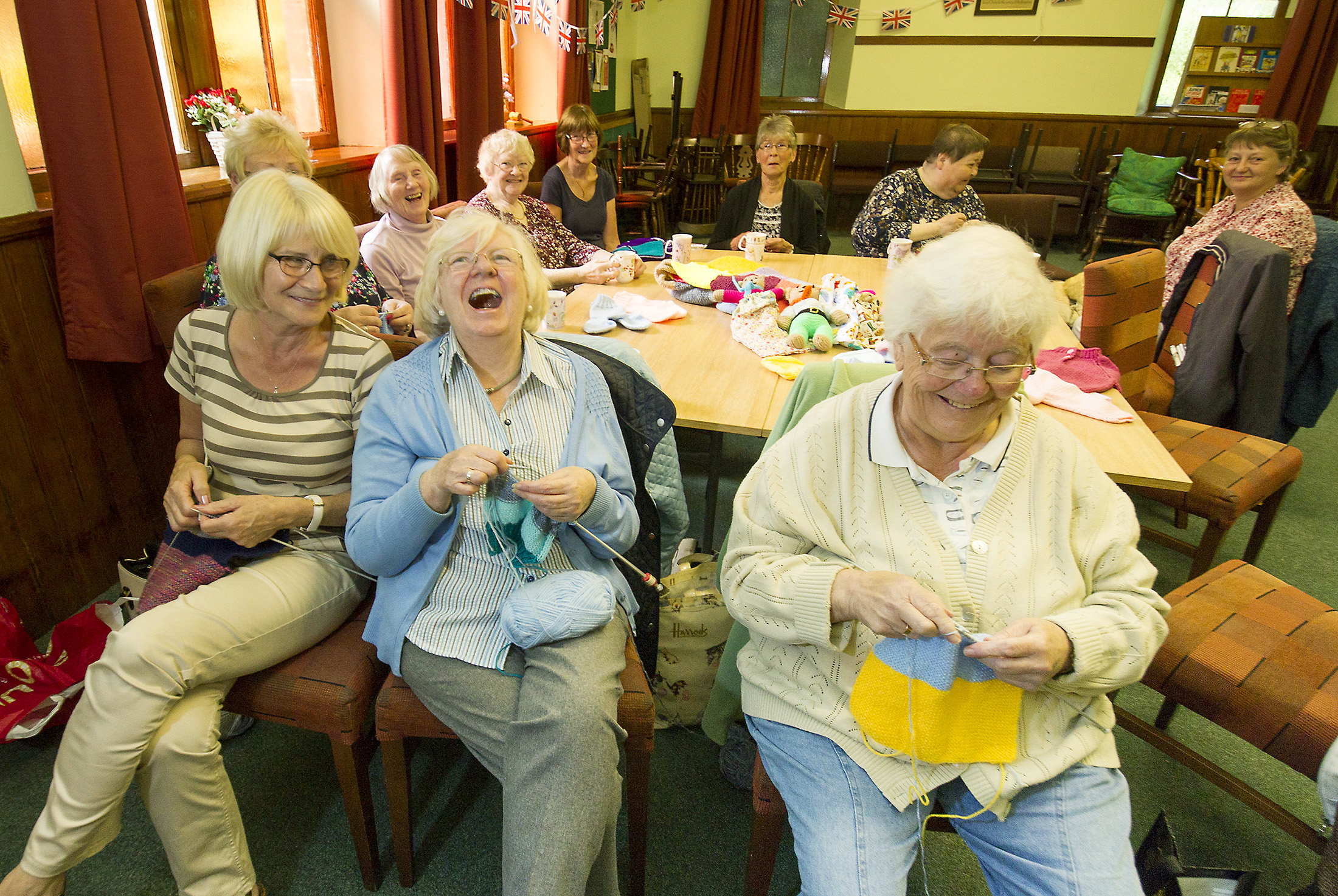 Barry Church knitting group hand over the donation of the first four boxes of knitting to the Raven Trust for Malawi.